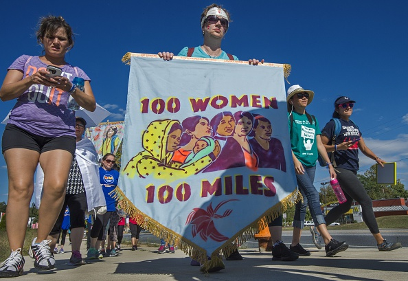 Participants in the  100 Women-100 Mile Pilgrimage   walk on a road after a lunch break on their trek, after stopping at the University Maryland Baltimore County on Sep. 20, 2015.
