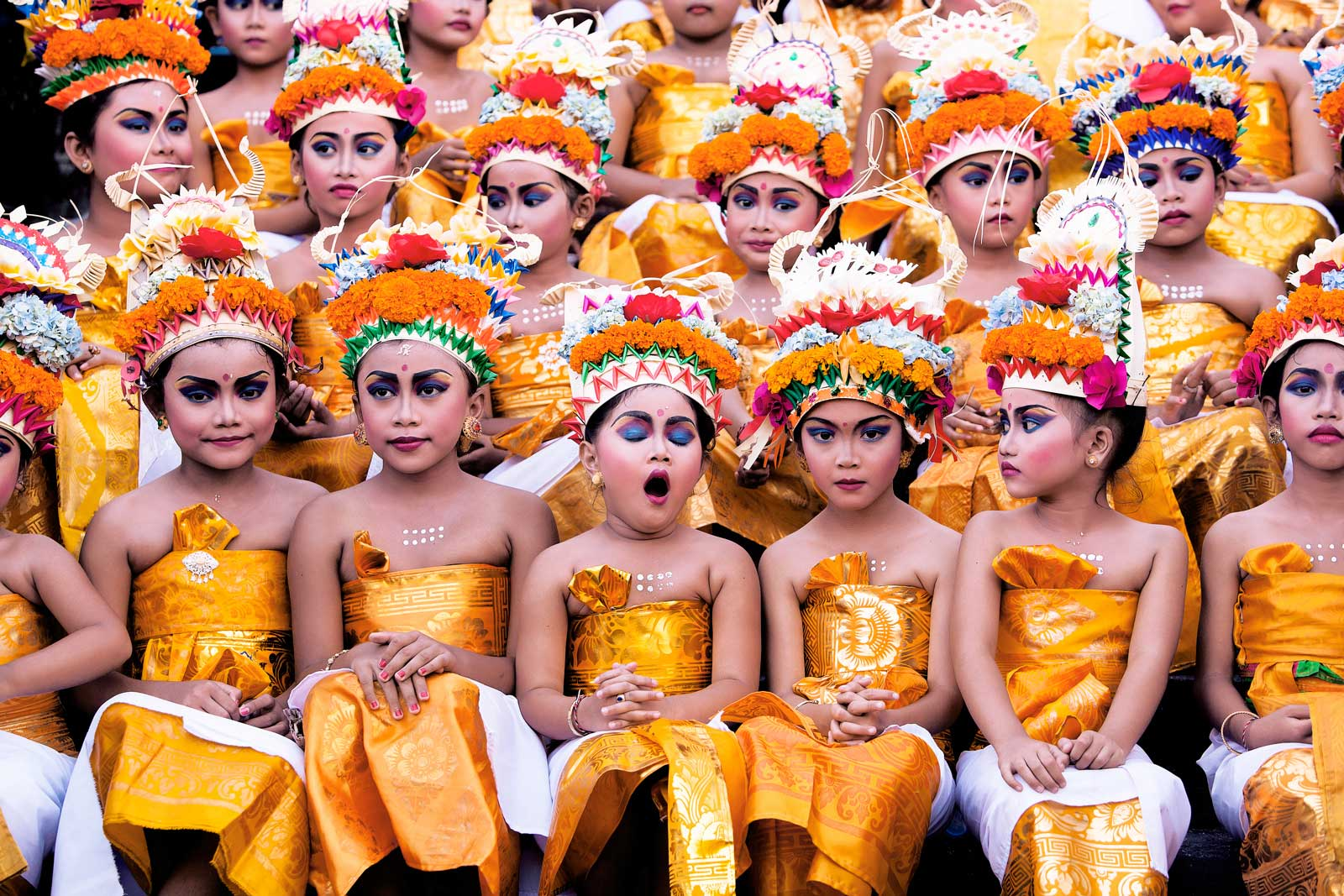 Young girls wait for their turn to perform at the Melasti Festival in Bali, which is conducted once a year in conjunction with Nyepi or Silent Day.