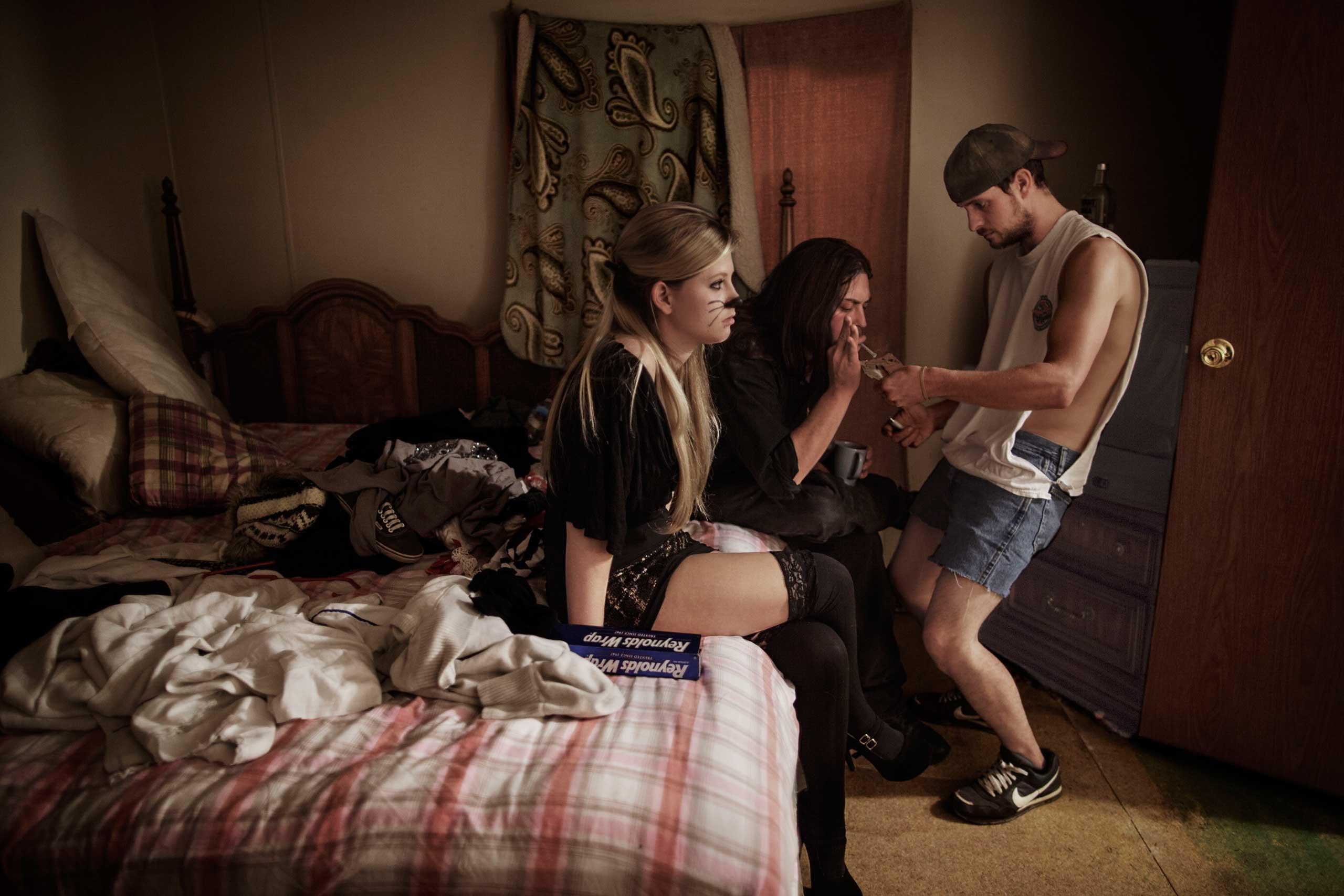 Chelse, 21, together with her boyfriend, Eric, and Alvin in her mother's trailer close to Beckley, West Virginia. They smoke OxyContin painkiller's before going out for a party on Halloween. With more than 500 people dying of overdose every year, West Virginia is the number one pill state in the U.S.