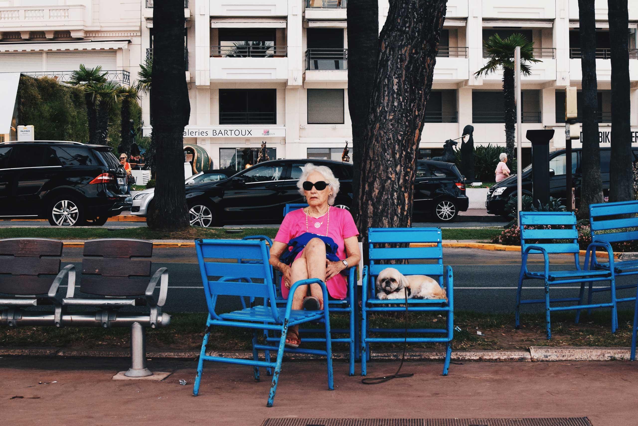 A woman relaxes along the Promenade de la Croisette in Cannes, France in 2015.