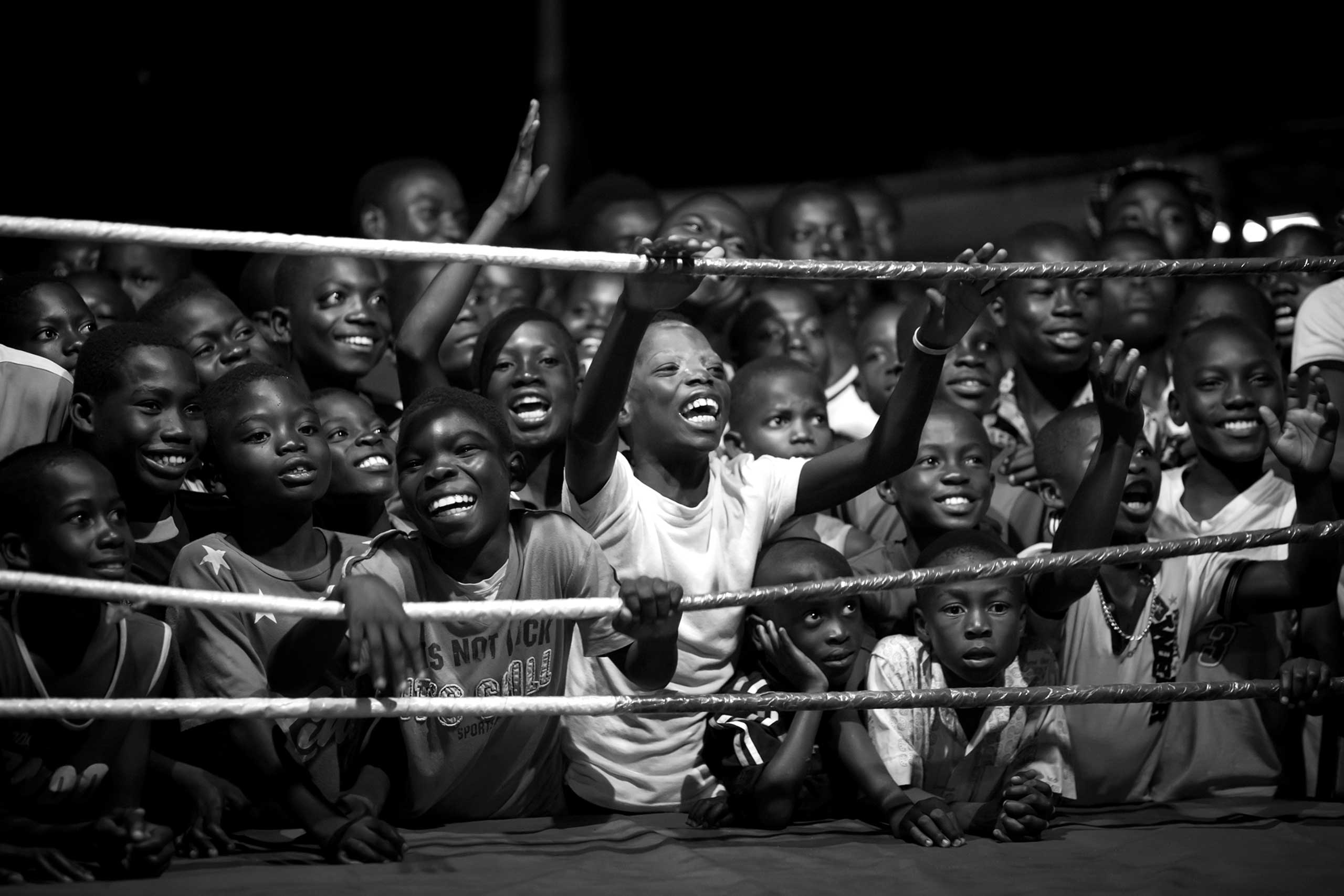Young boys cheer at a boxing match in Bukom, a small neighborhood of Accra in Ghana, which has produced all of the country's world champions.