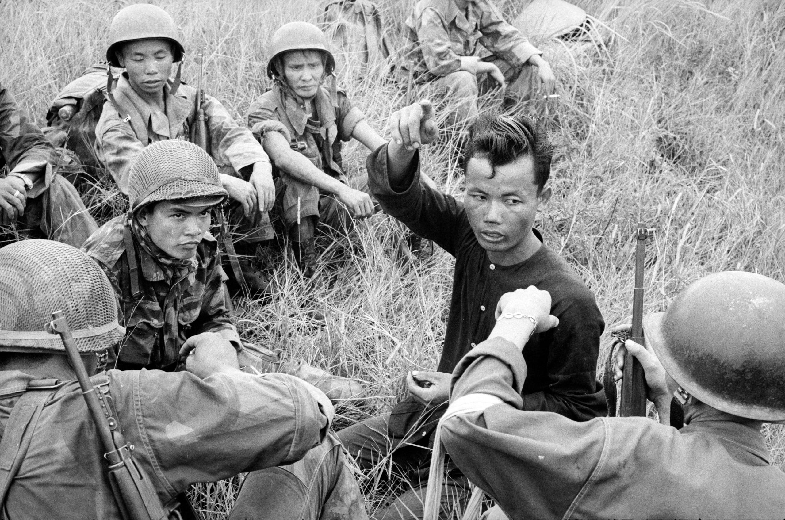 Vietnamese soldiers interrogate suspected Vietcong, ca. 1961-62.