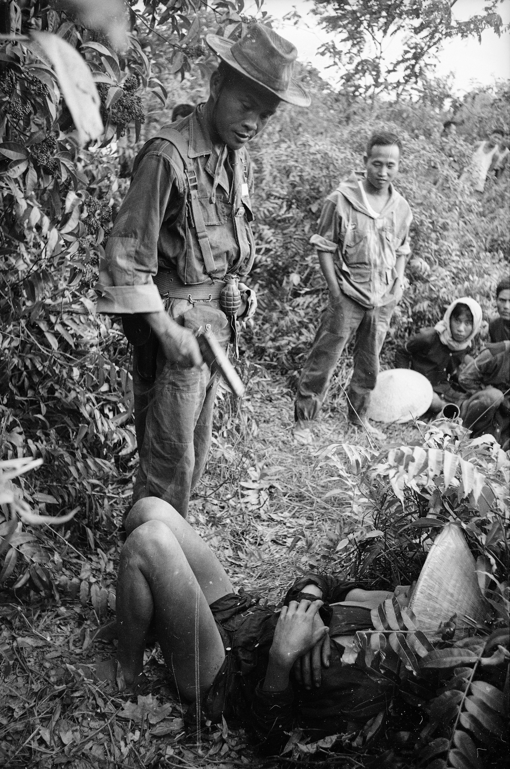 South Vietnamese troops interrogate Vietcong, 1962.