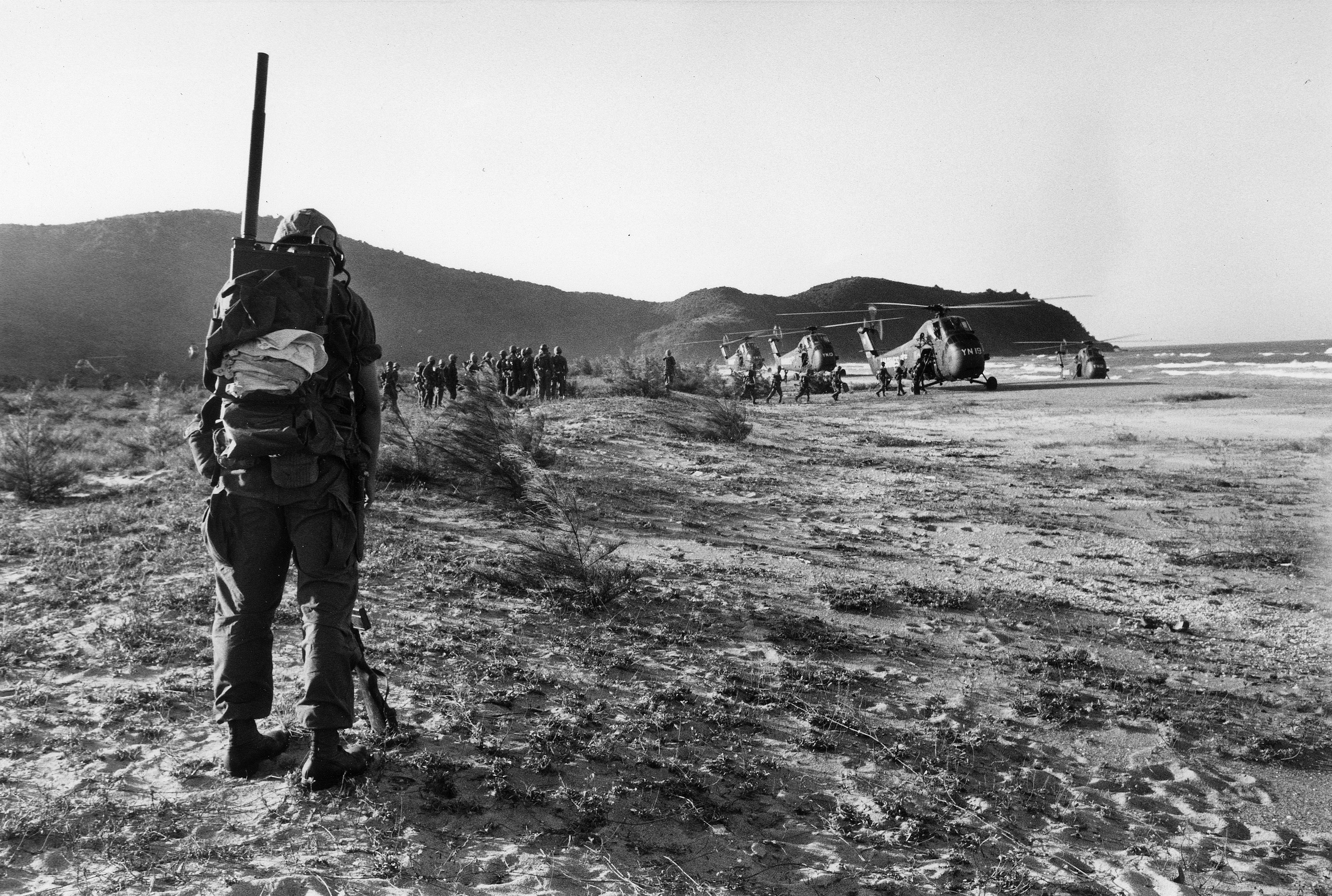 Marines wait to load helicopters, 1965.