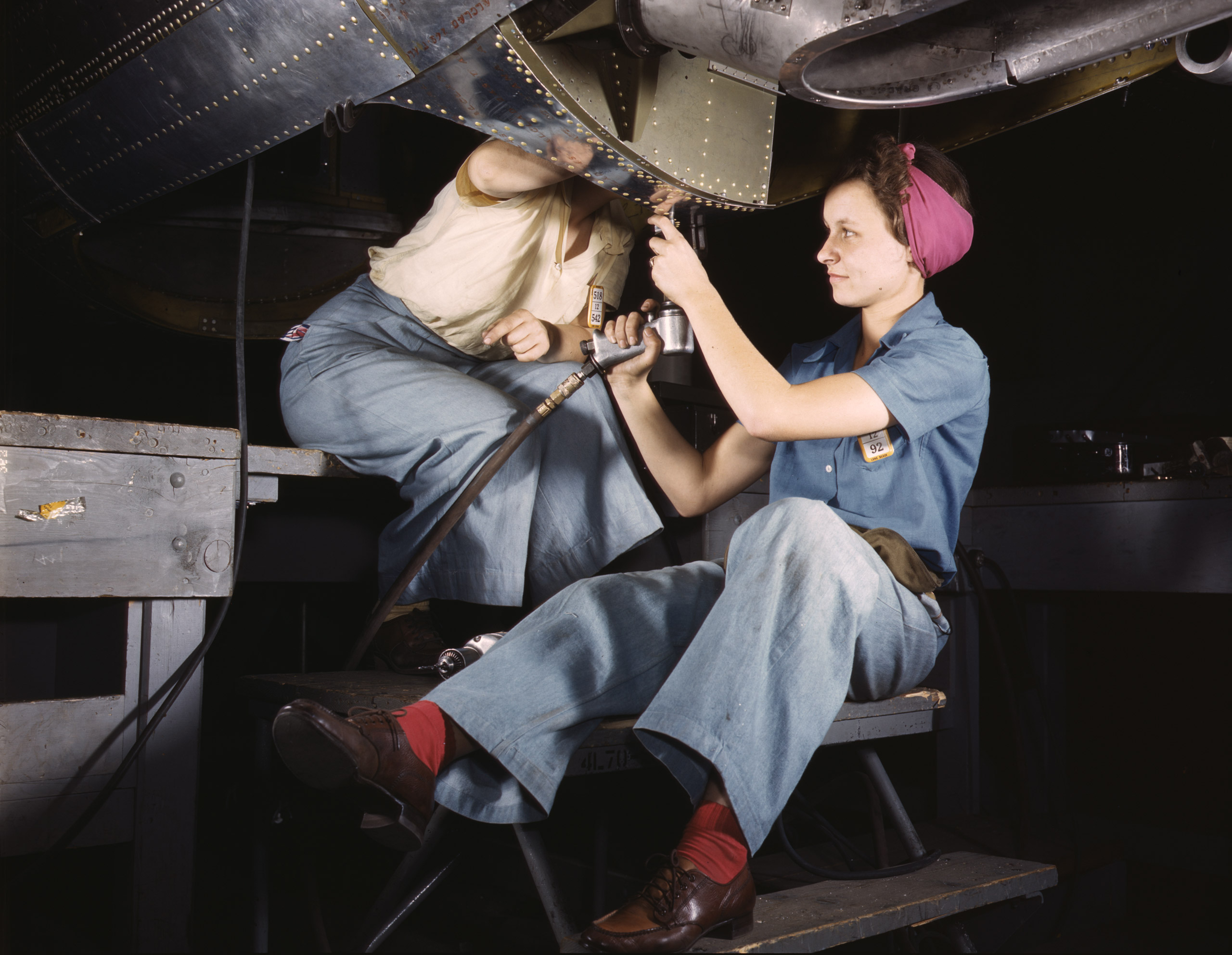 Women at work on C-47 Douglas cargo transport, Douglas Aircraft Company, Long Beach, Calif, October 1942. Photographed by Alfred T. Palmer for the Farm Security Administration.