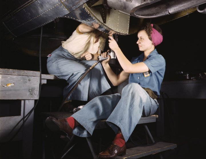 Women at work on C-47 Douglas cargo transport, Douglas Aircraft Company, Long Beach, California, October 1942. Photographed by Alfred T. Palmer for the Farm Security Administration.