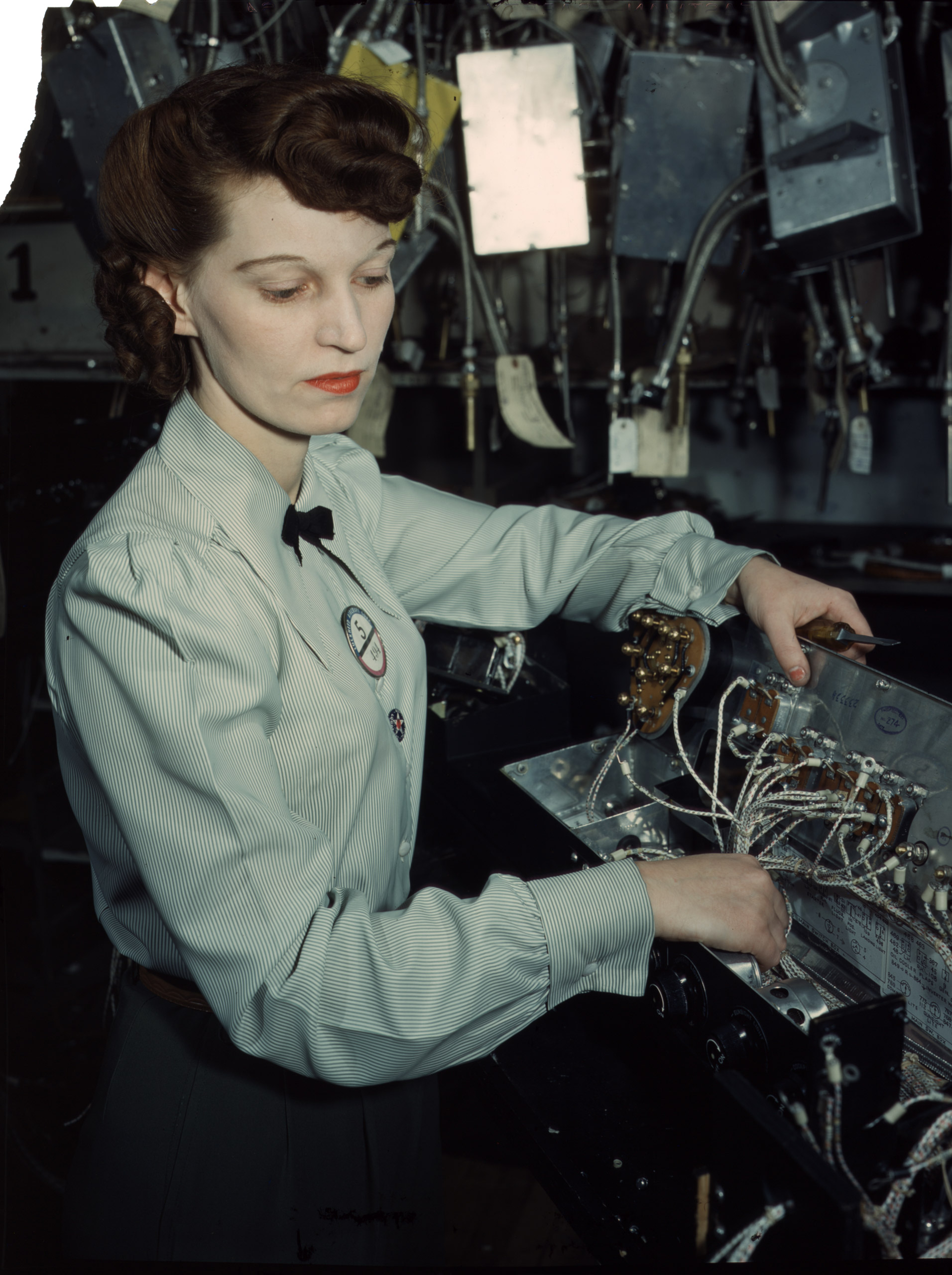 Electronics technician, Goodyear Aircraft Corp., Akron, Ohio, December 1941. Photographed by Alfred T. Palmer for the Farm Security Administration.