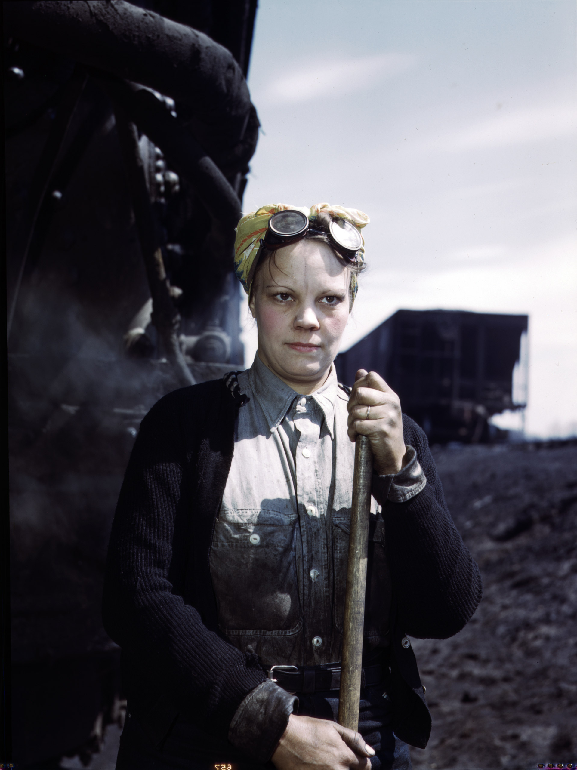 Chicago and North Western Railway Company, Mrs. Irene Bracker, mother of two children, employed at the roundhouse as a wiper, Clinton, Iowa. April 1943. Photographed by Jack Delano for the Farm Security Administration.