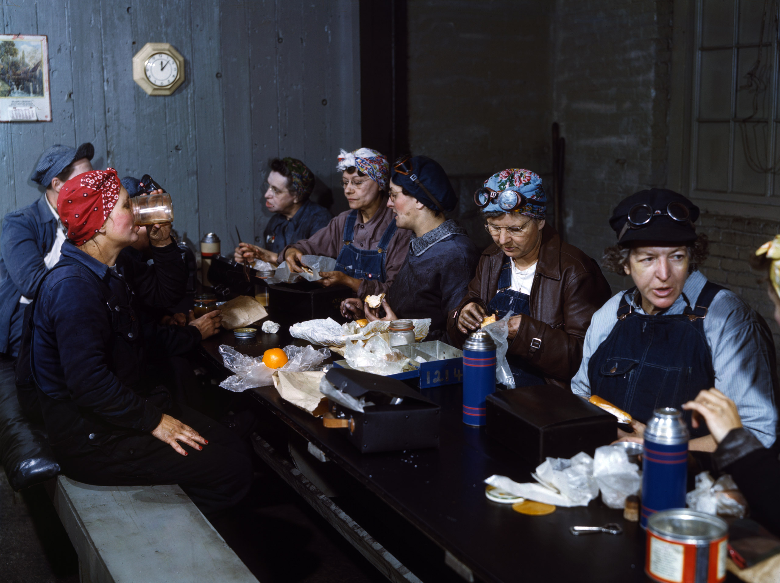 Women workers employed as wipers in the roundhouse having lunch in their rest room, Chicago and North Western Railway Company, Clinton, Iowa, April 1943. Photographed by Jack Delano for the Farm Security Administration.