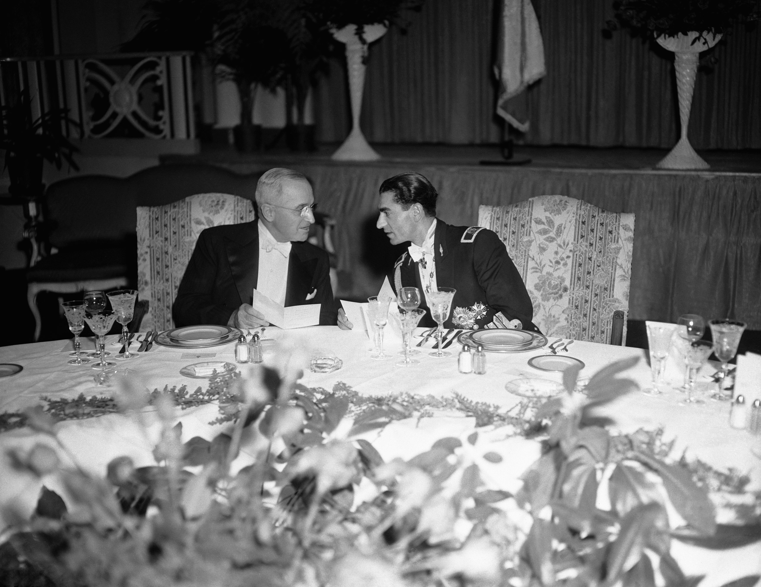President Harry Truman and the Shah of Iran, Mohammed Reza Pahlavi, at the official dinner given by the visiting ruler at the Shoreham Hotel. Washington D.C., Nov. 19, 1949.