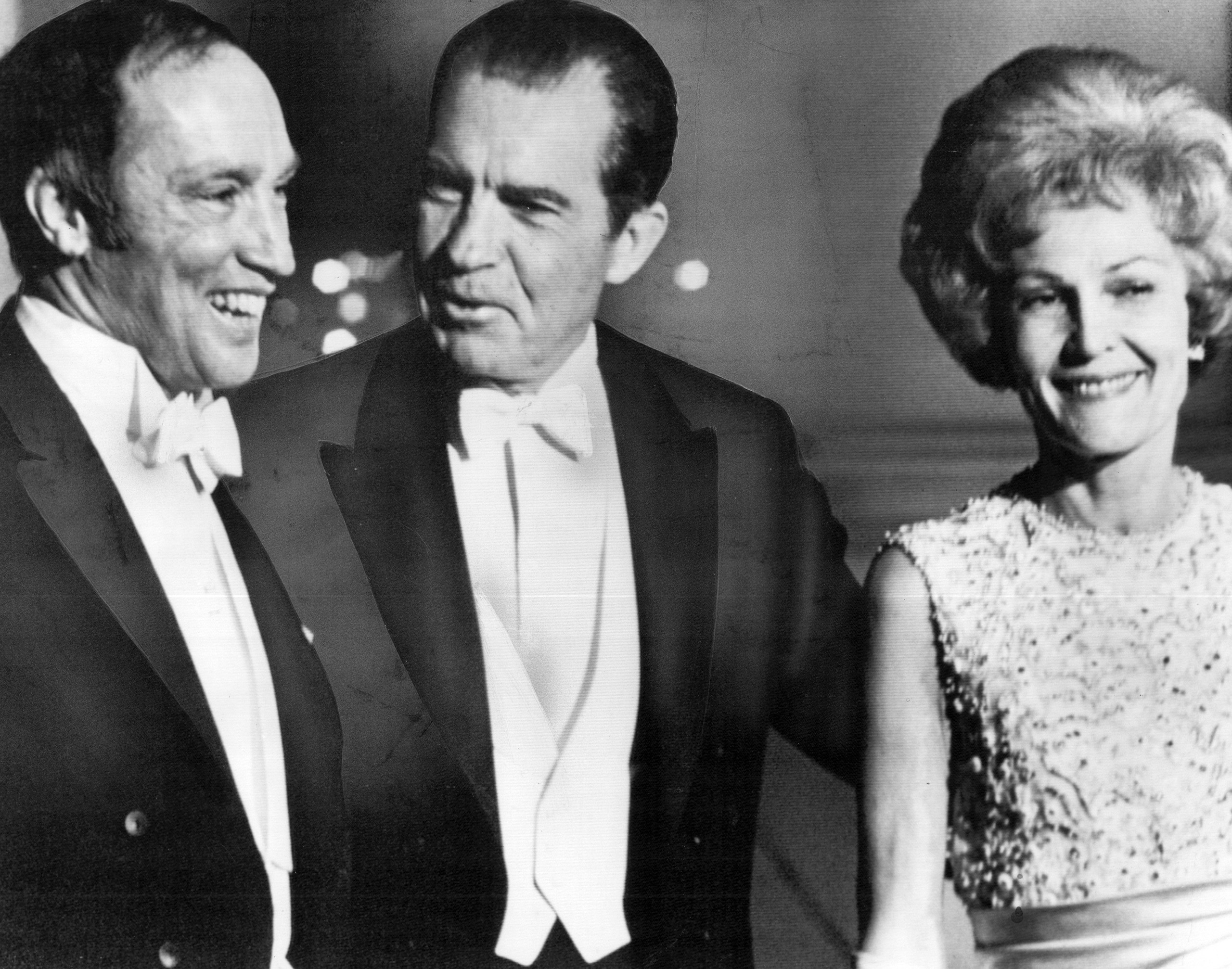 President and Mrs. Richard Nixon greet Prime Minister Pierre Elliott Trudeau at the North portico of the White House for a white-tie state dinner, the first of the Nixon administration. March 25, 1969.