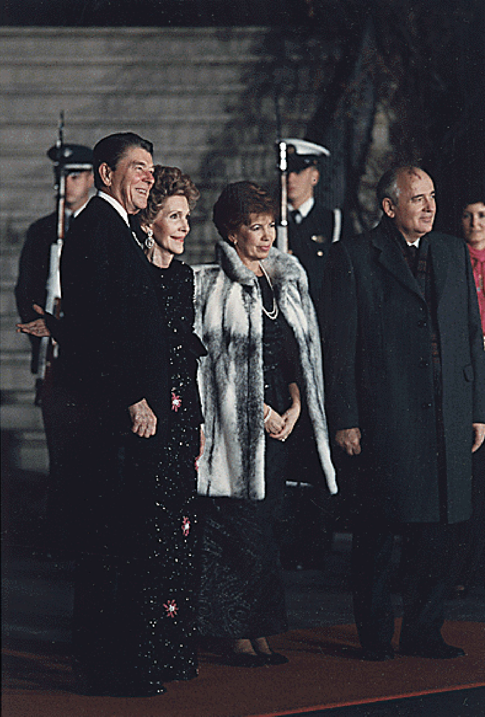 President Ronald Reagan and First Lady Nancy Reagan welcome USSR General Secretary Mikhail Gorbachev and his wife, Raisa, to the White House for a State Dinner in their honor. Dec. 8, 1987.