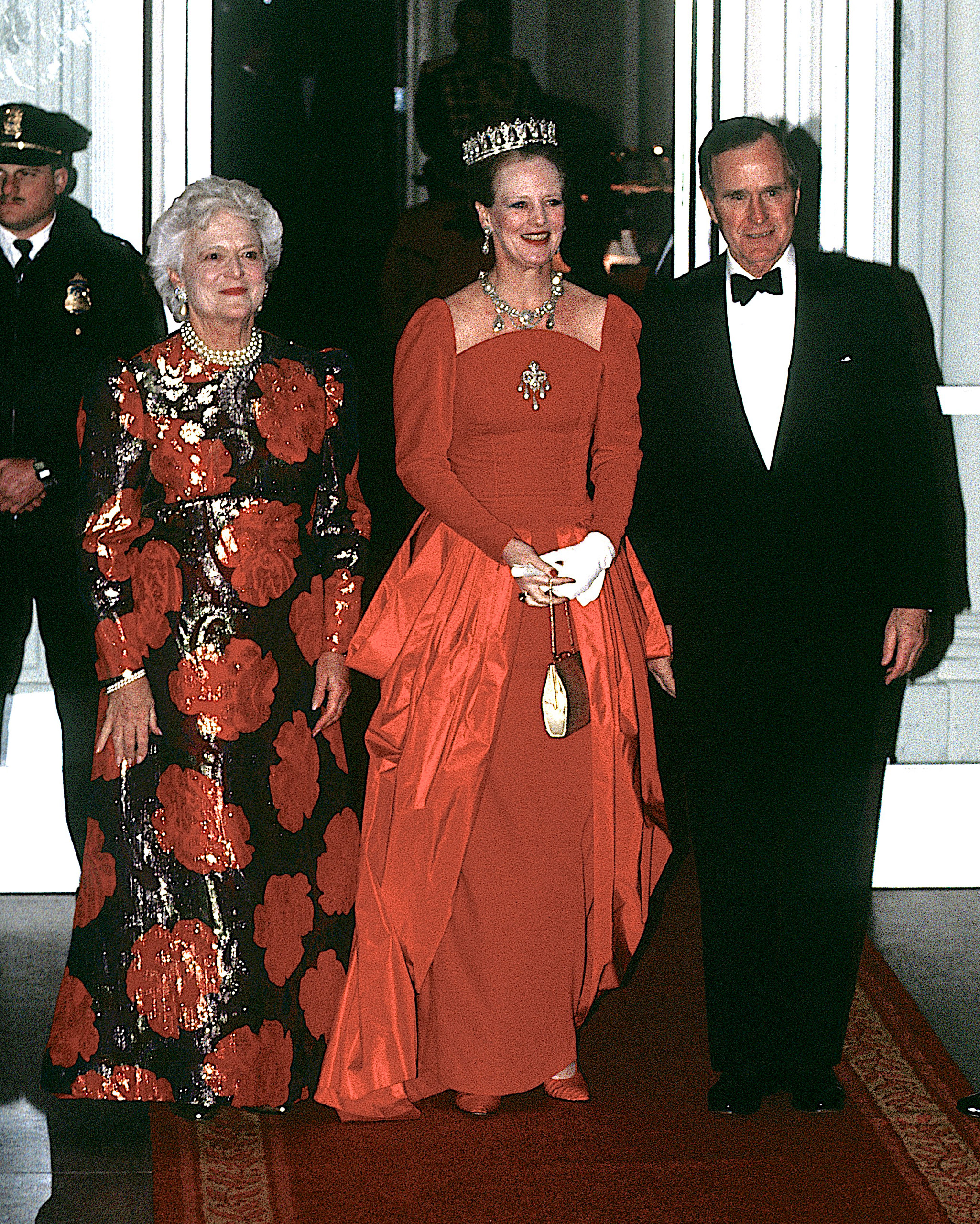 President George H.W. Bush and his wife Barbara pose at the entrance to the North portico of the White House with Queen Margrethe II of Denmark during their arrival for the evening's state dinner. Feb. 20, 1991.