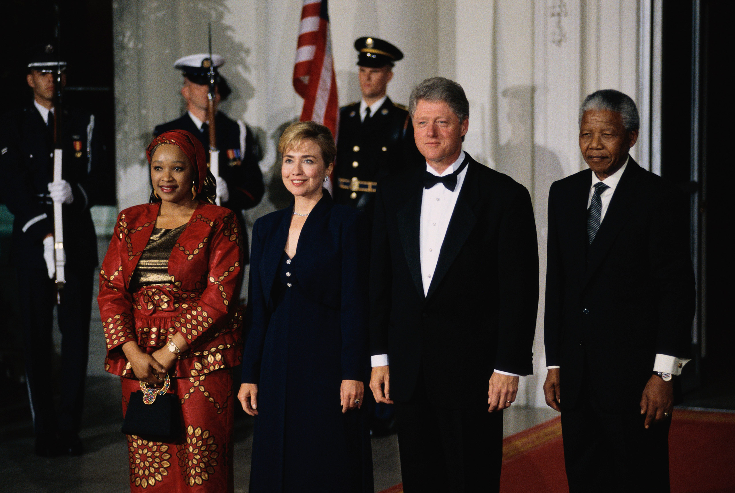 President and Mrs Clinton stand at the North Portico of the White House with South African President Nelson Mandela and his daughter before a State Dinner honoring the South African president. Oct. 4, 1994.