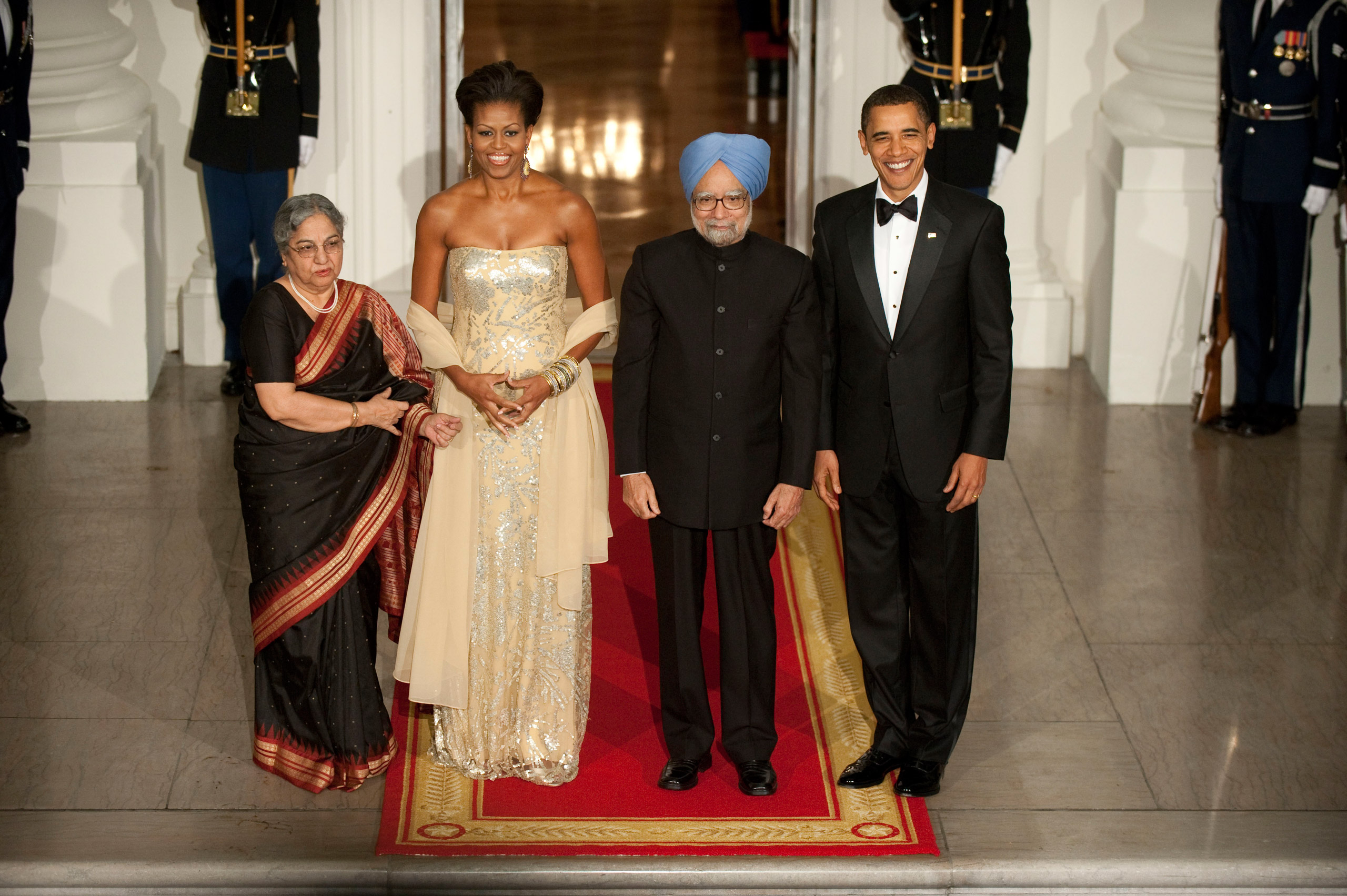 President Barack Obama and First Lady Michelle Obama welcome Indian Prime Minister Dr. Manmohan Singh  and Mrs. Gursharan Kaur to their first White House State Dinner.