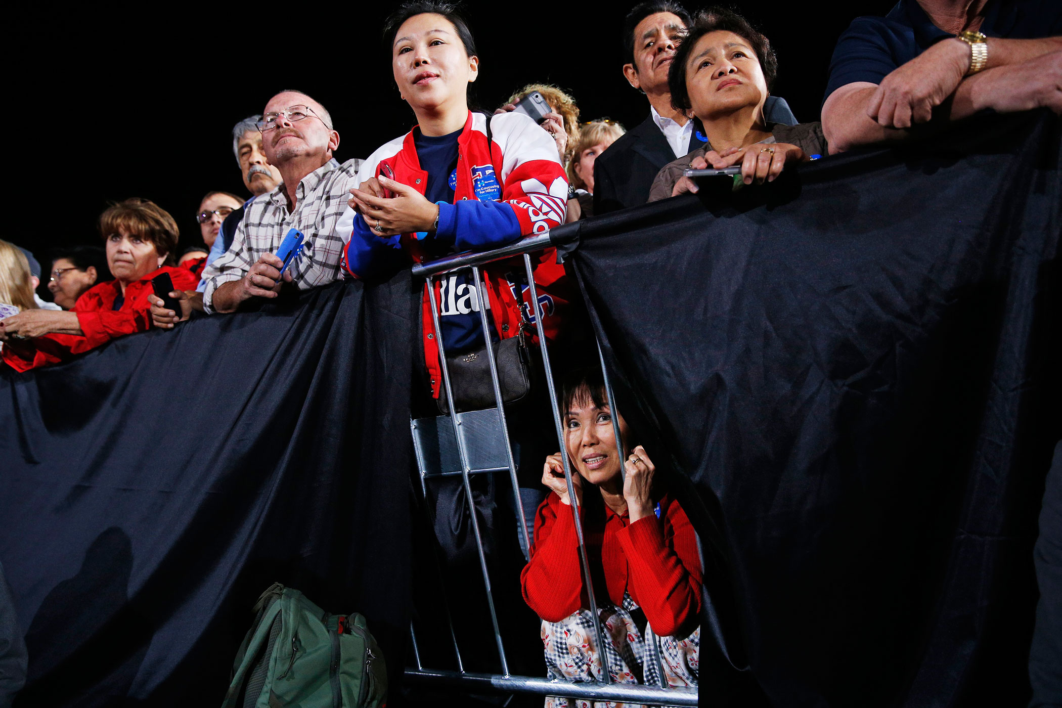 Supporters watch Hillary Clinton speak during a rally on Feb. 19, 2016, in Las Vegas.