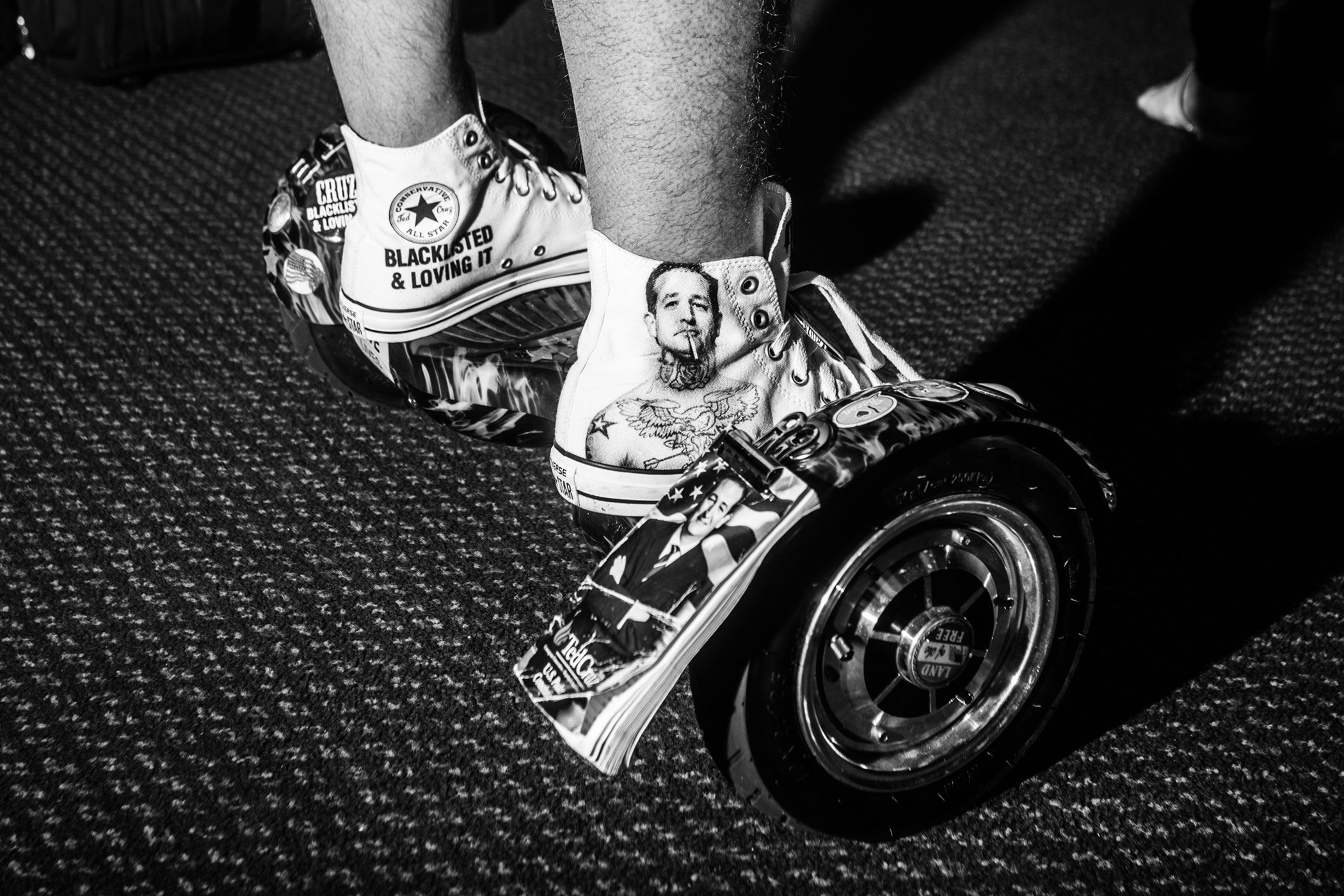A Ted Cruz supporter rides a hover-board to a Nevada Courageous Conservatives Rally with Glenn Beck and Ted Cruz in Henderson, Nev. on Feb. 21, 2016.