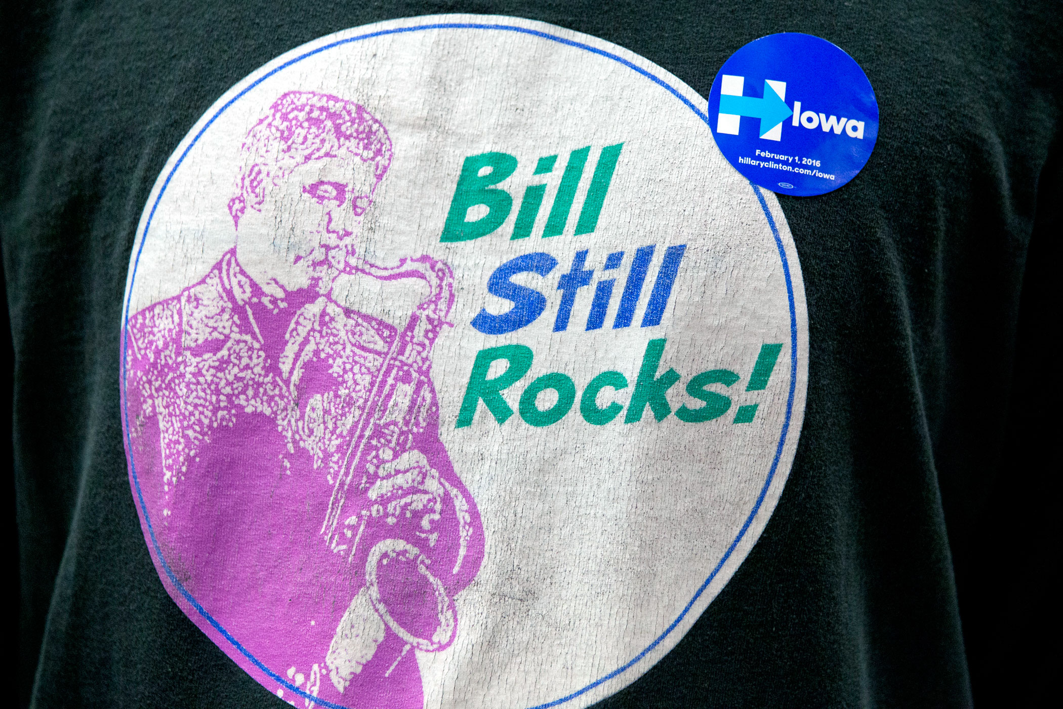 A Hillary Clinton supporter wears a T-shirt featuring Bill Clinton playing the saxophone during a campaign event at the Keokuk Middle School on Jan. 28, 2016, in Keokuk, Iowa.