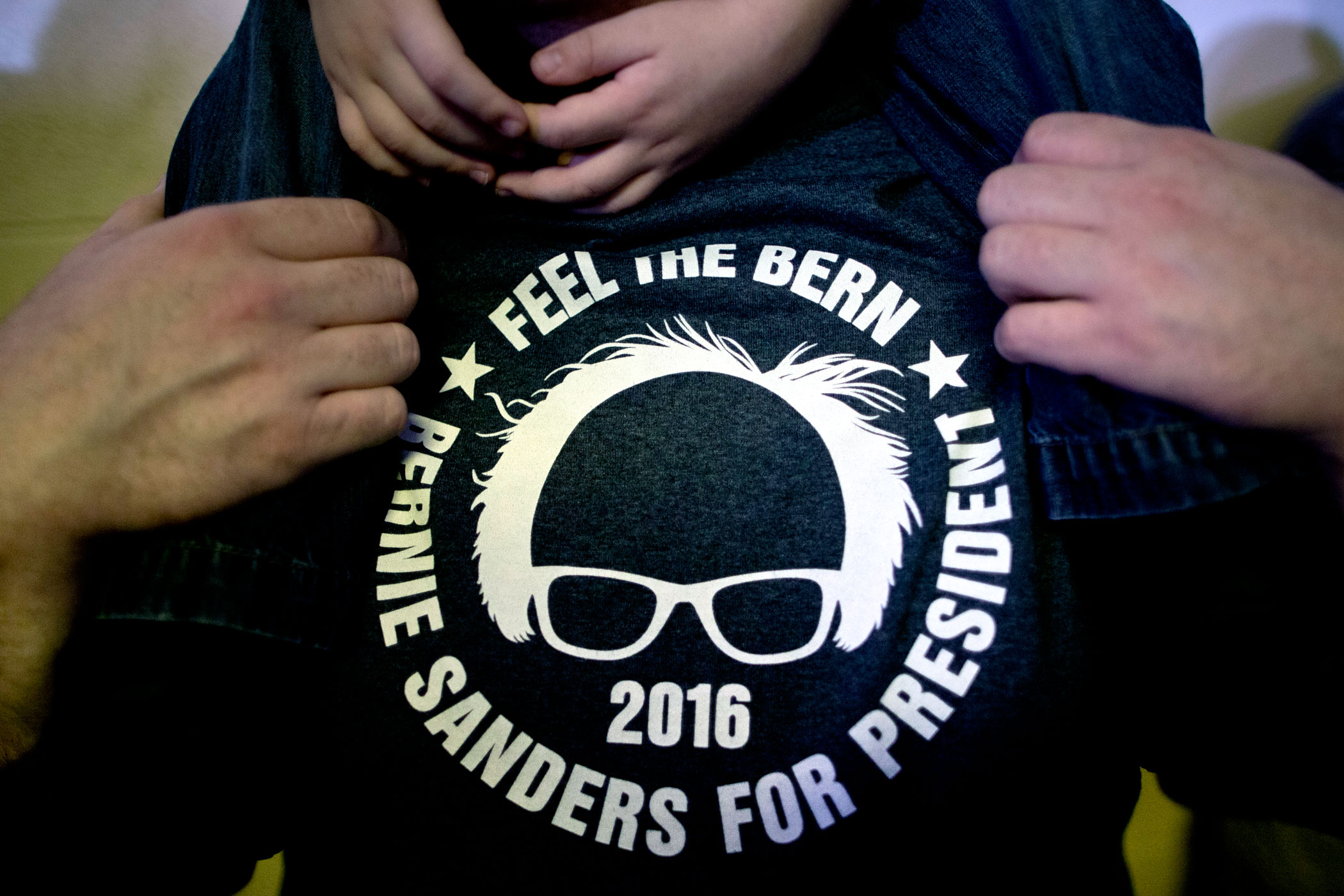 A man wears a shirt supporting Sen. Bernie Sanders, I-Vt., at a campaign event on Jan. in Clinton, Iowa.
