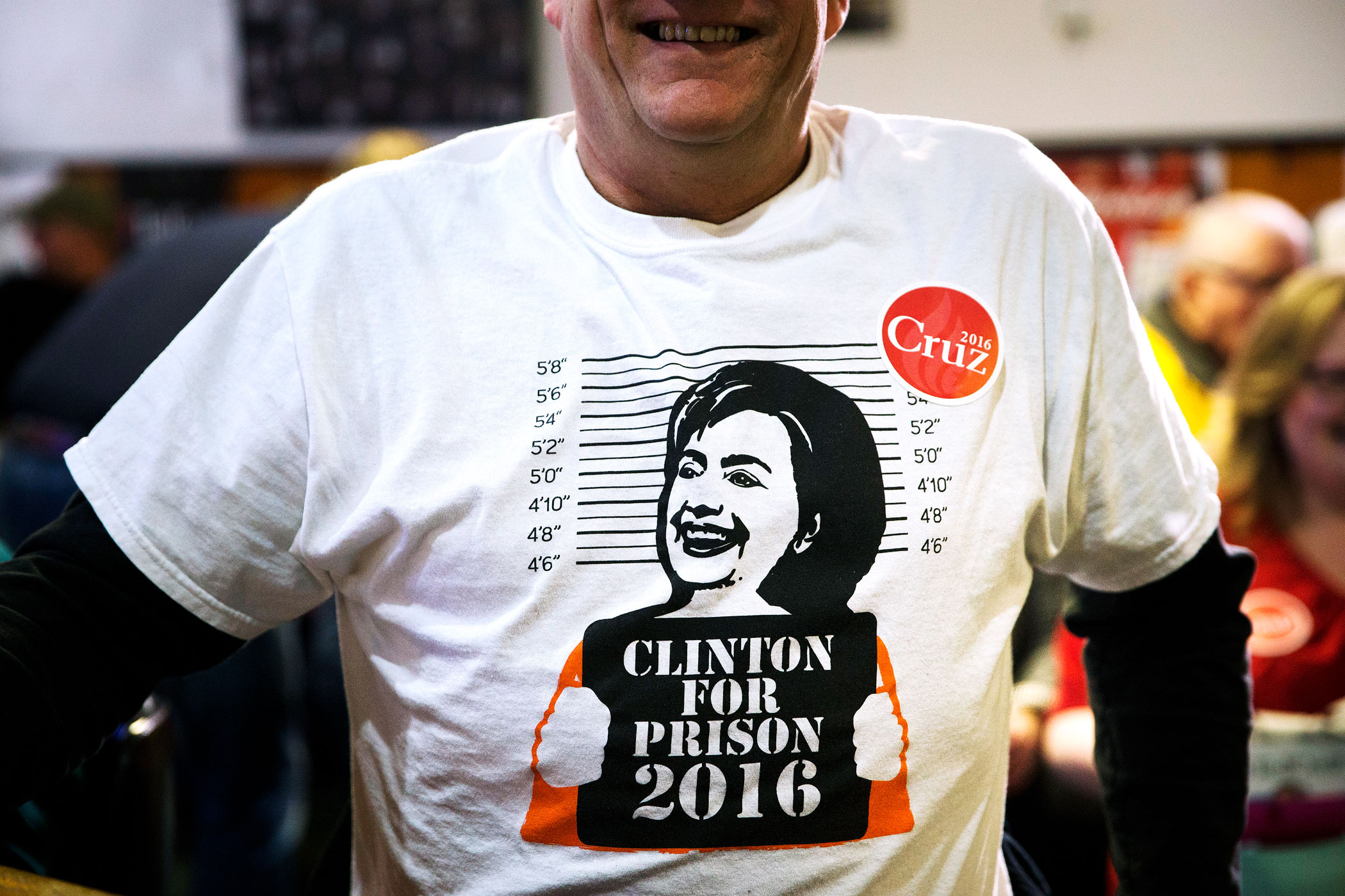 Mike Rasmussen, wearing a t-shirt opposing Hillary Clinton attends a campaign stop for Republican presidential candidate, Texas Sen. Ted Cruz on Jan. 29 in Ringsted, Iowa.