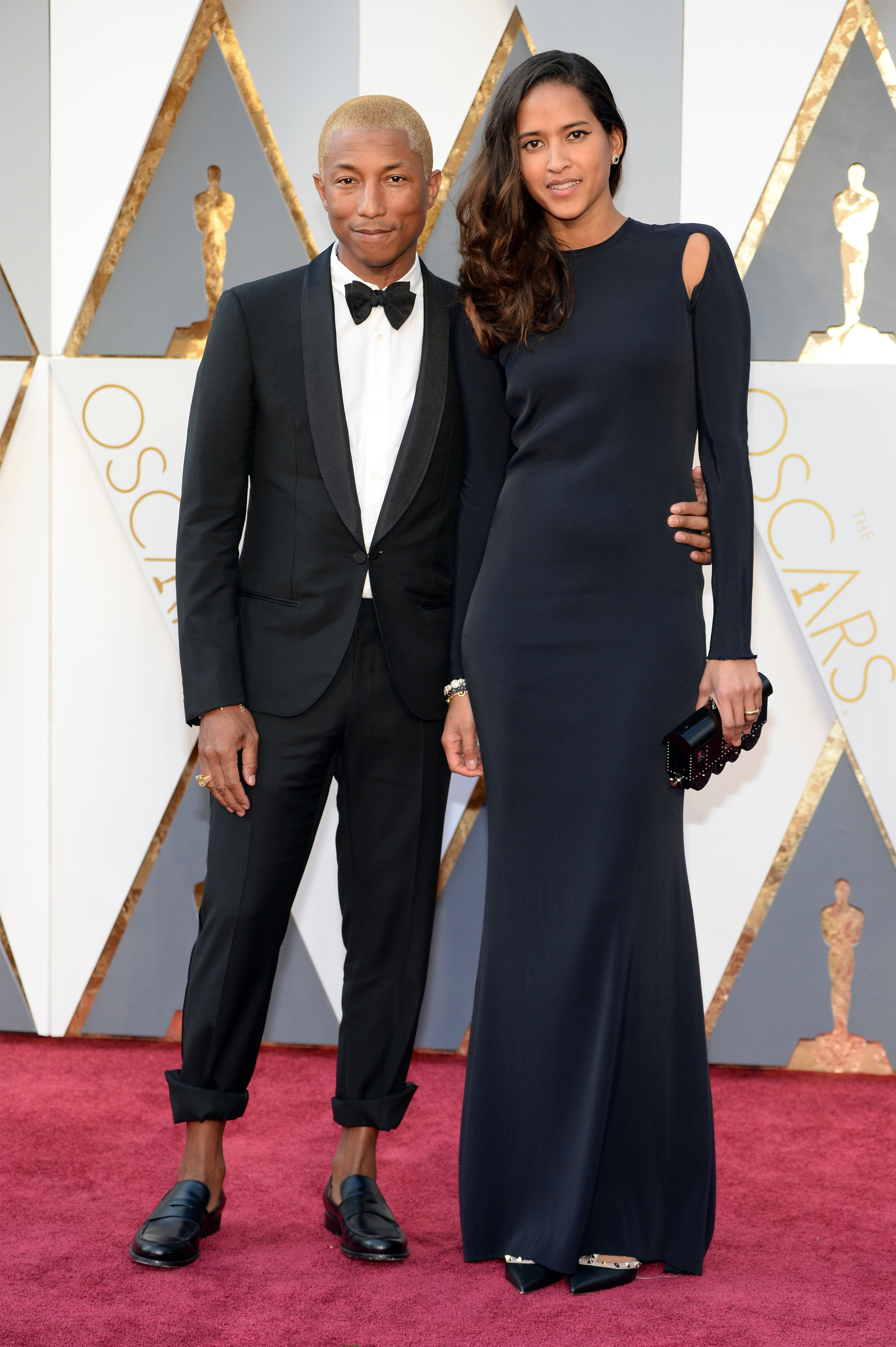 Pharrell Williams and Helen Lasichanh attend the 88th Annual Academy Awards on Feb. 28, 2016 in Hollywood, Calif.