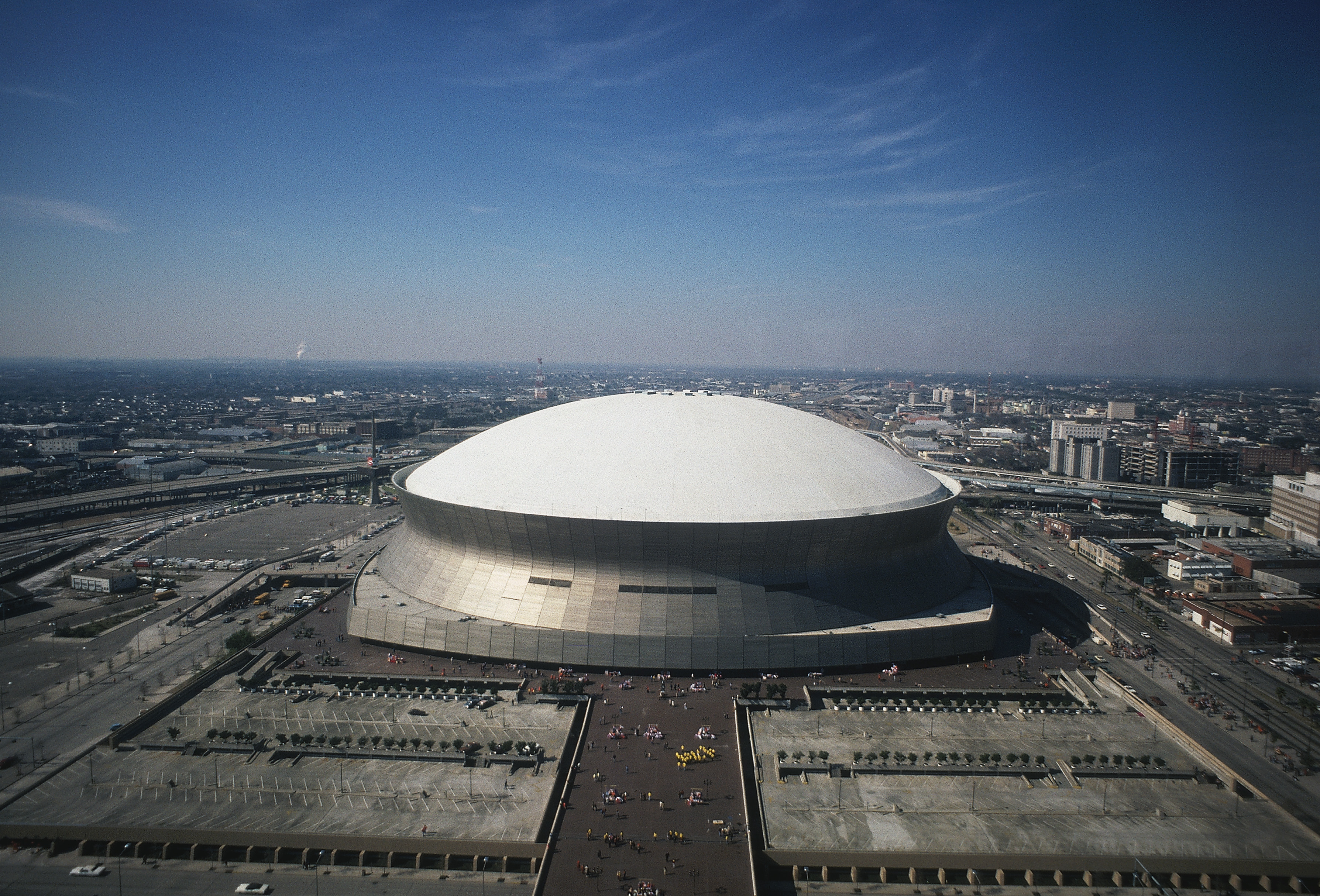 """The Mercedes-Benz Superdome, which opened to the public in New Orleans in 1975 as the Louisiana Superdome, has been the site of a Muhammad Ali boxing match, Rolling Stones concert and a papal address, in addition to multiple Super Bowls. The stadium, also a """"refuge of last resort"""" for 30,000 Hurricane Katrina evacuees, has been home to the New Orleans Saints, Tulane Green Wave, New Orleans Jazz, and the New Orleans Breakers."""