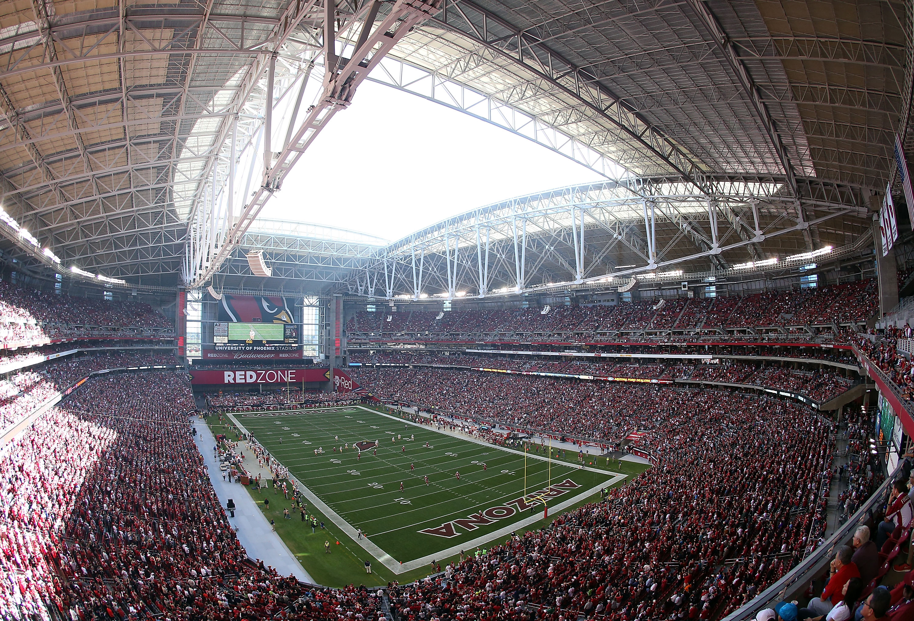 The University of Phoenix Stadium in Glendale, Ariz. has both a retractable roof and field for its multipurpose use. It's home to both the Arizona Cardinals and the college football Fiesta Bowl. True to its roots, the stadium's exterior is designed to represent a barrel cactus.