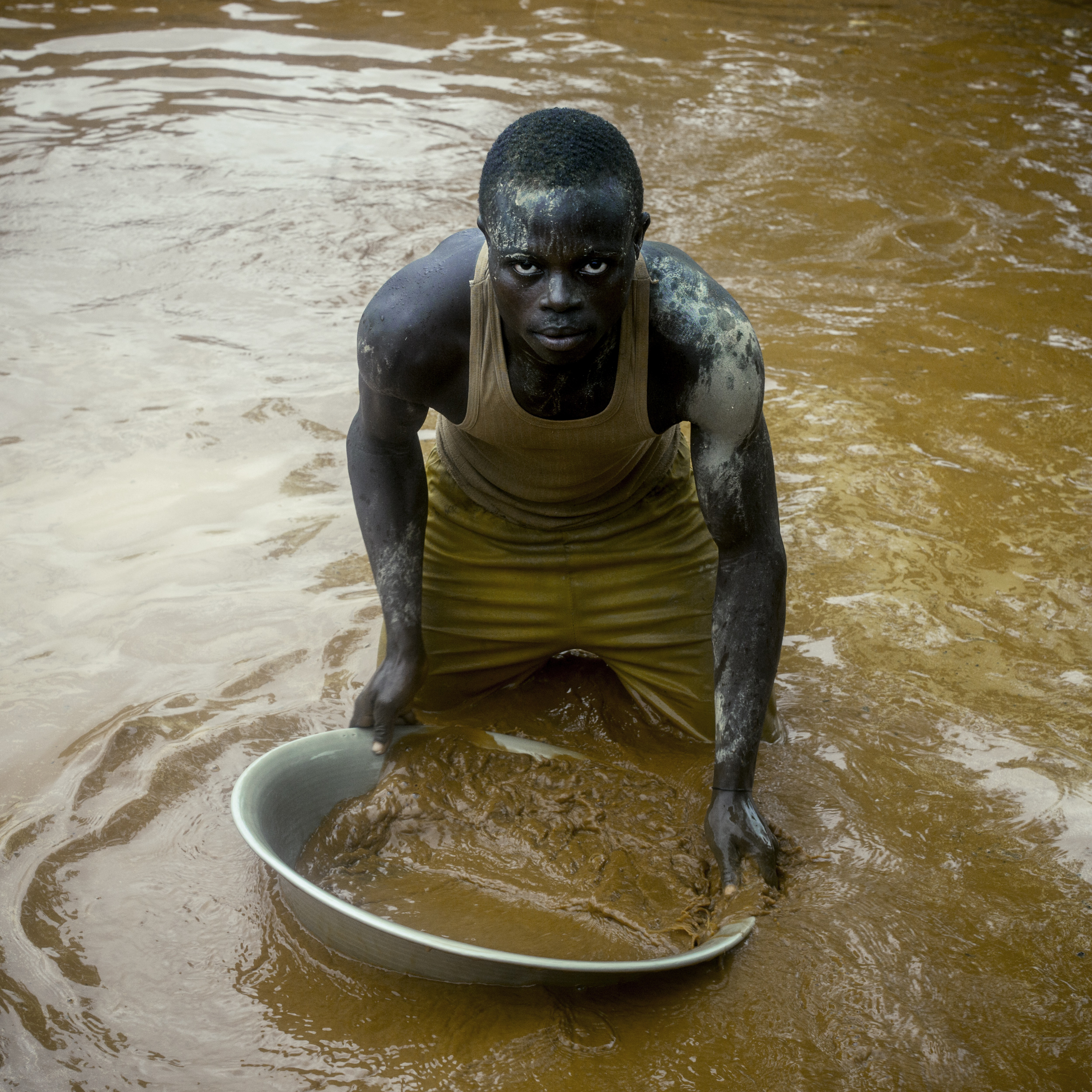 A man looks for gold in the Ndassima gold mine near Bambari, Central African Republic, July 28, 2015.