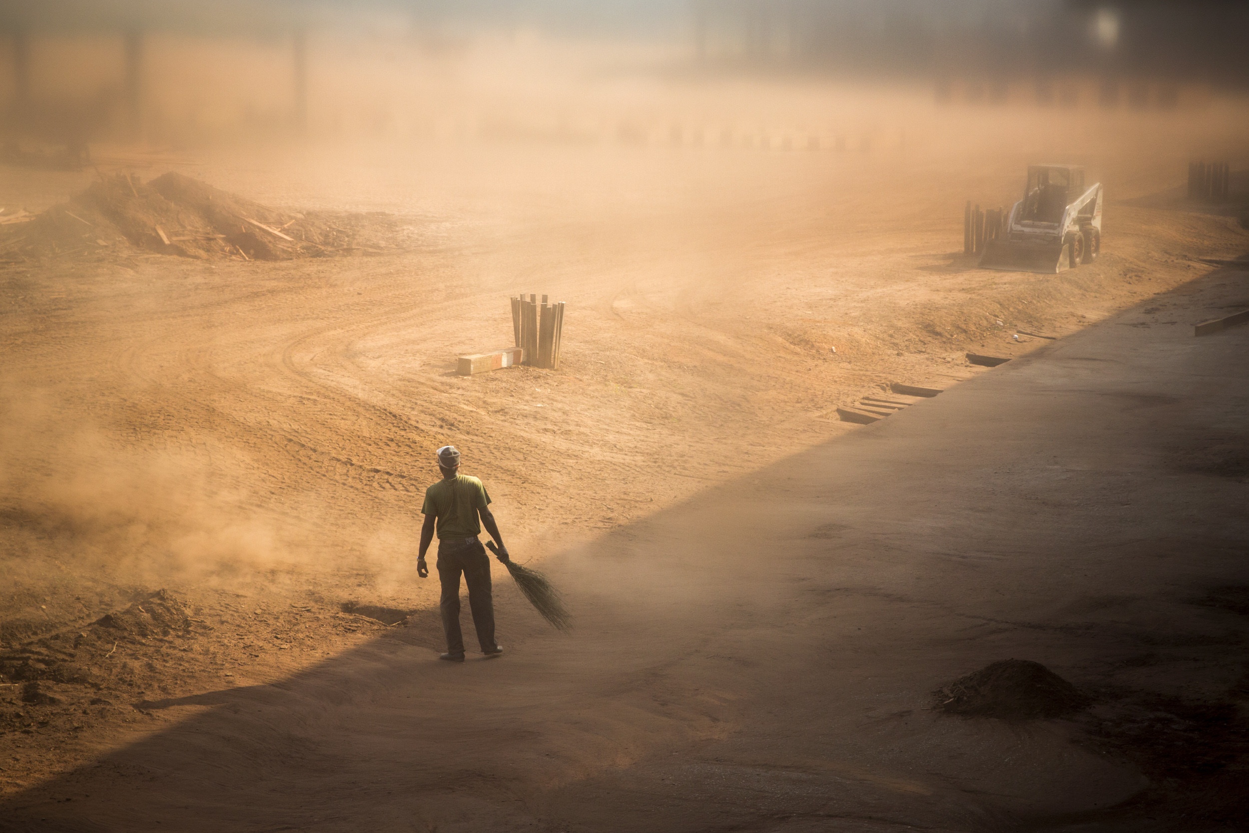 A worker sweeps wood dust at a timber factory near Mambelé, Central African Republic, Dec. 11, 2015. According to a report released by Global Witness last July, foreign logging companies paid millions of euros to Muslim rebels known as Séléka and mostly Christian militias known as antibalaka. Logging companies claim they are forced, like any other companies in the country, to pay bribes for security against attacks. The sector employed approximately 4,000 people—and apparently supported 6,000 indirect jobs, a figure that is now in decline, according to the Minister of Forests.