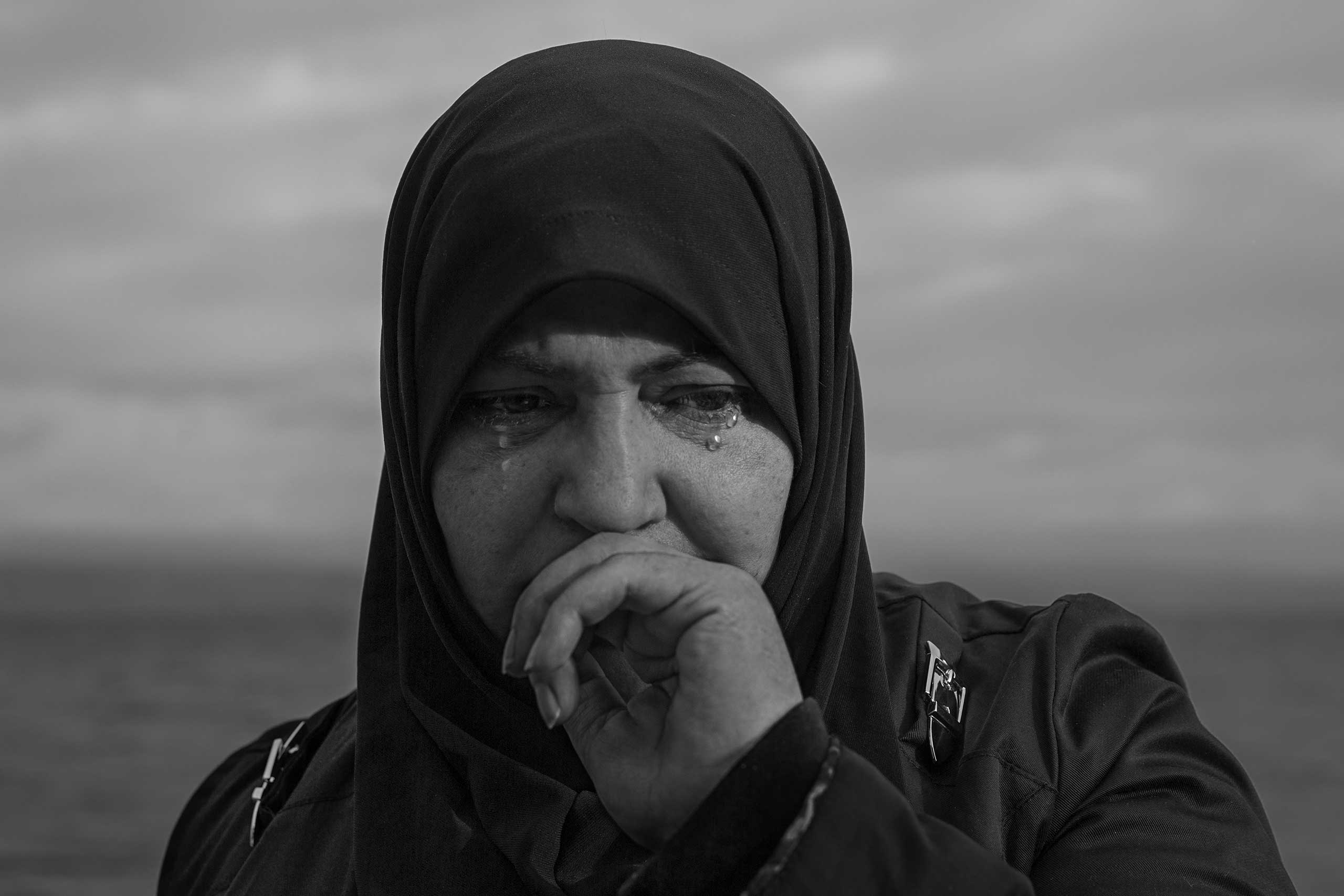 A woman cries after her boat arrives on the island of Lesbos, Greece.