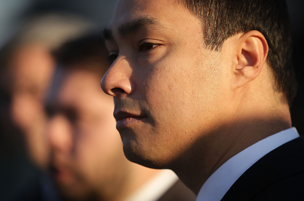 U.S. Rep. Joaquin Castro (D-TX) listens during a news conference in front of the Supreme Court in Washington, D.C., on Dec. 8, 2015.