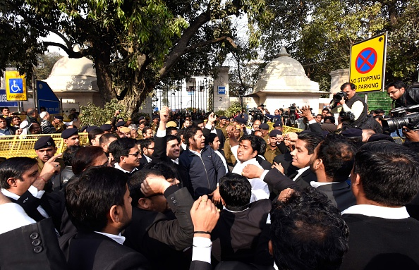 A mob attacks protesters and journalists inside the Patiala House court premises on Feb. 15, 2016, in New Delhi. The students and journalists had gone to the court for the bail hearing of Jawaharlal Nehru University students' union president Kanhaiya Kumar, who has been arrested on charges of sedition for allegedly raising anti-India slogans