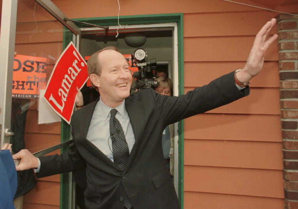DES MOINES, IA - FEBRUARY 12:  Republican presidential candidate Lamar Alexander waves to supporters as he leaves a local sandwich shop after a campaign stop 12 February in Des Moines, Iowa. Iowa caucus voting will take place later in the evening. JOHN RUTHROFF—AFP/Getty Images