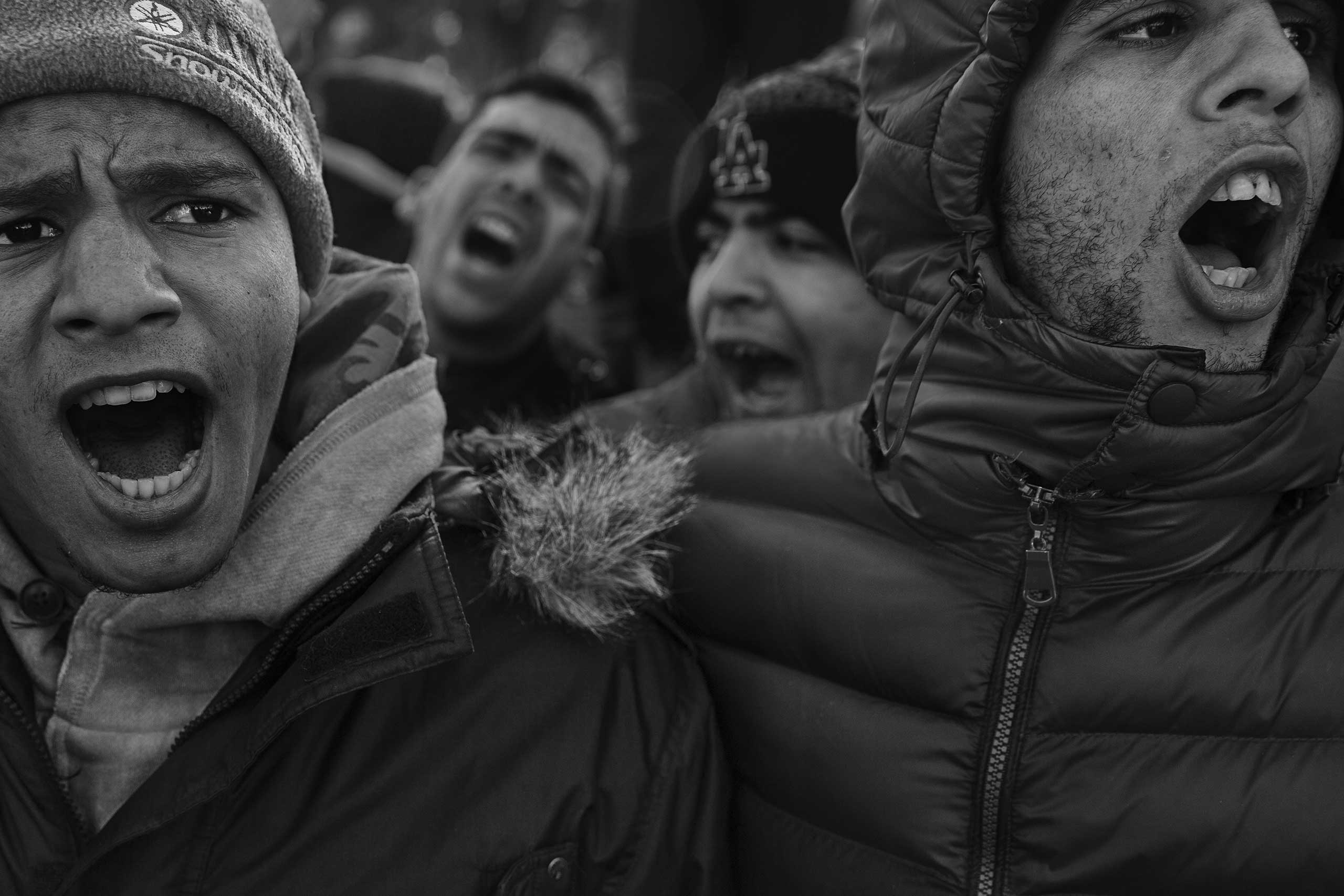Iranian migrants shout during a demonstration at the Macedonian border in the Greek village of Idomeni after crossing was restricted only to migrants and refugees from the war torn countries of   Afghanistan, Iraq and Syria.
