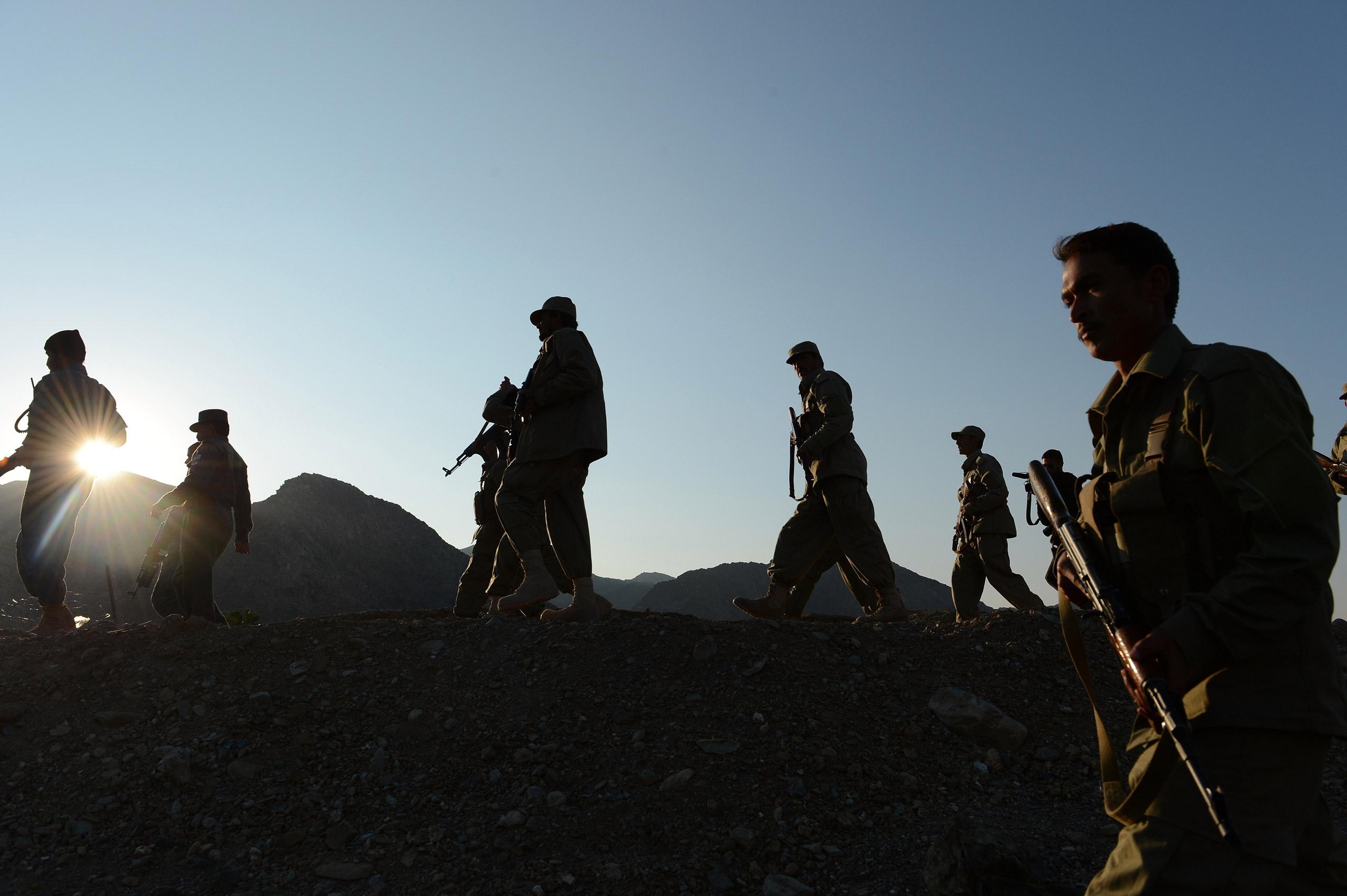 Afghan Local Police (ALP) personnel patrol near their base in Goshta district of Nangarhar province, on Dec. 18, 2012.