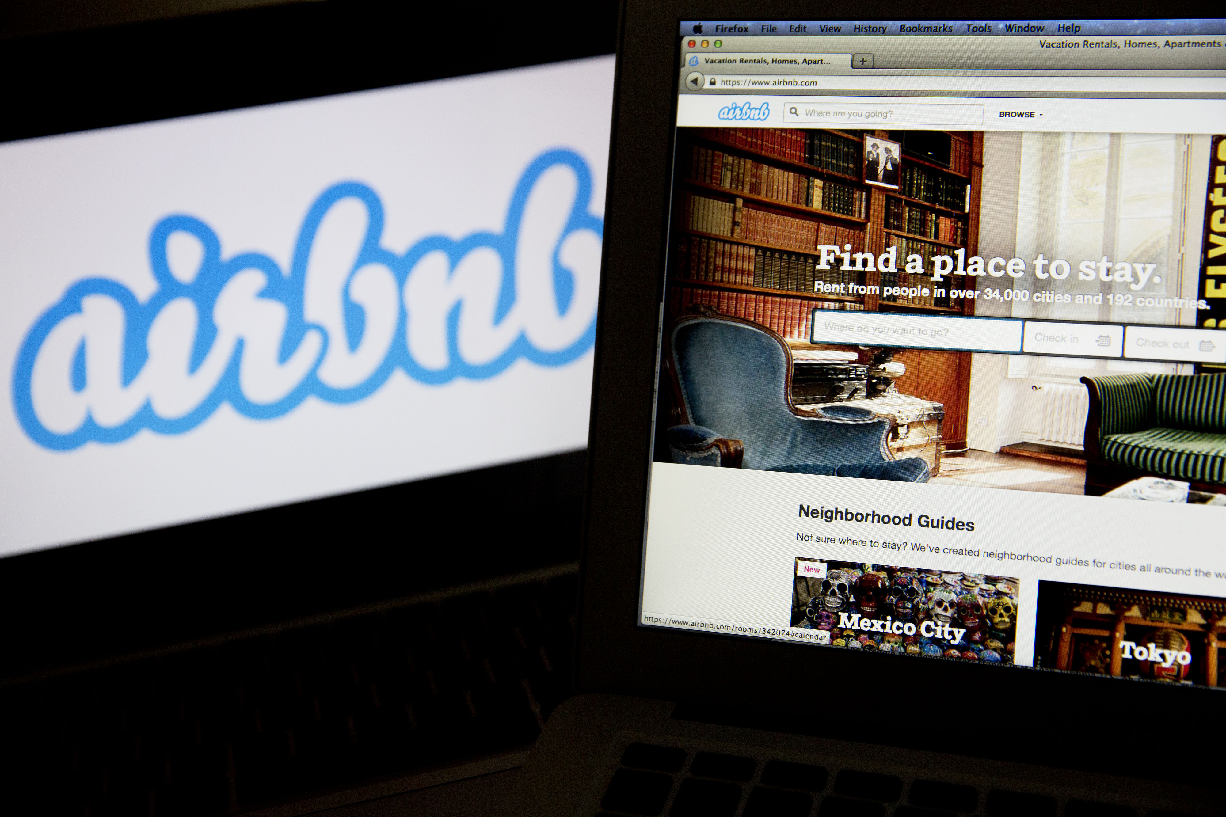 The Airbnb Inc. logo and website are displayed on laptop computers in this arranged photograph in Washington, D.C., U.S., on Friday, March 21, 2014.