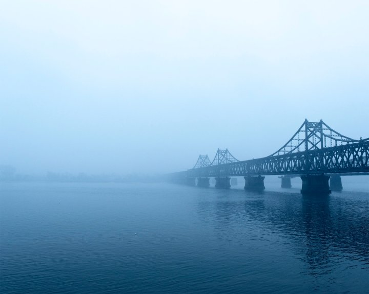 The Sino-Korean Friendship Bridge spans the Yalu River, connecting the cities of Dandong, China, and Sinuiju, North Korea.