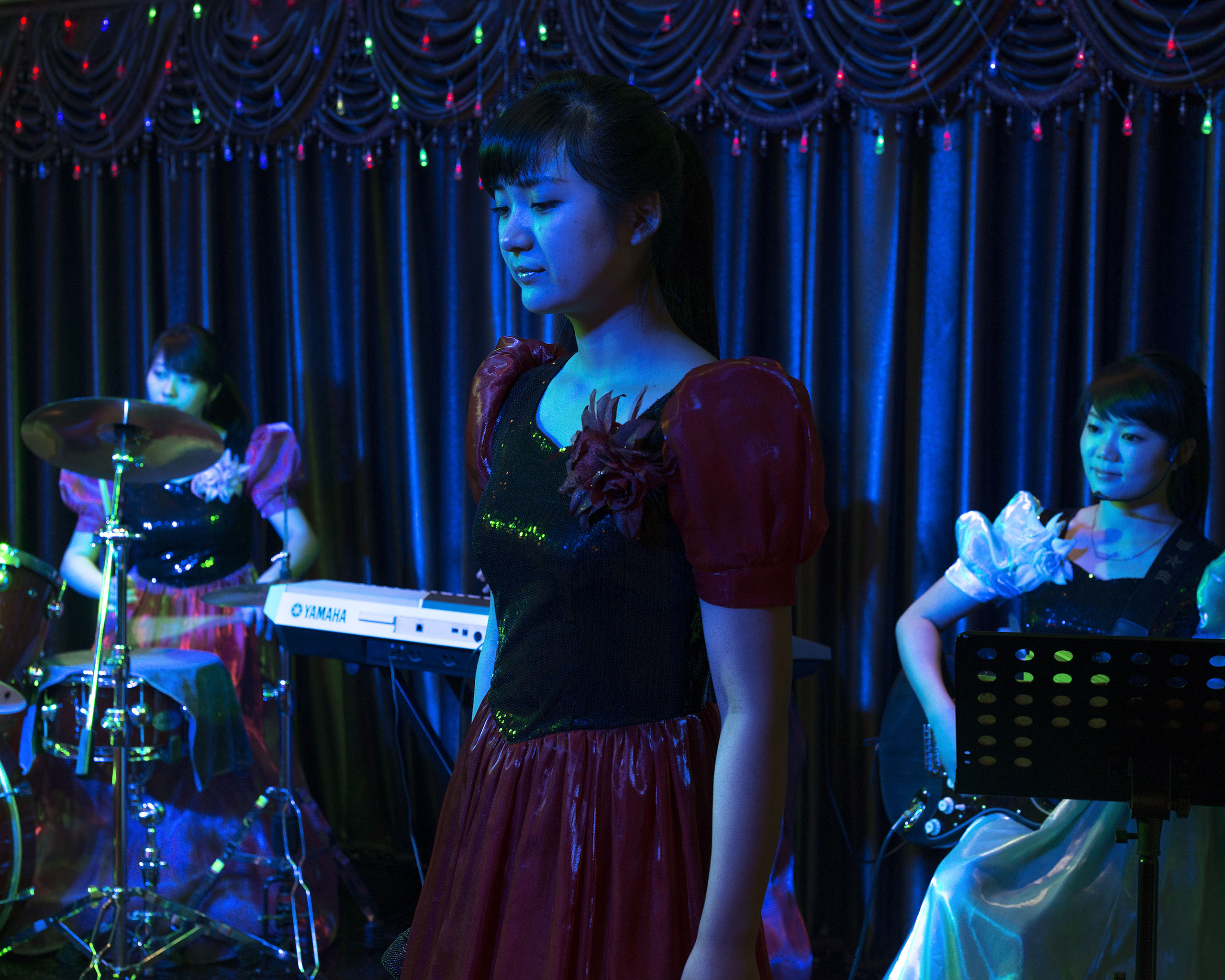A North Korean  performer at a traditional musical show in a North Korean restaurant near Tumen, China.