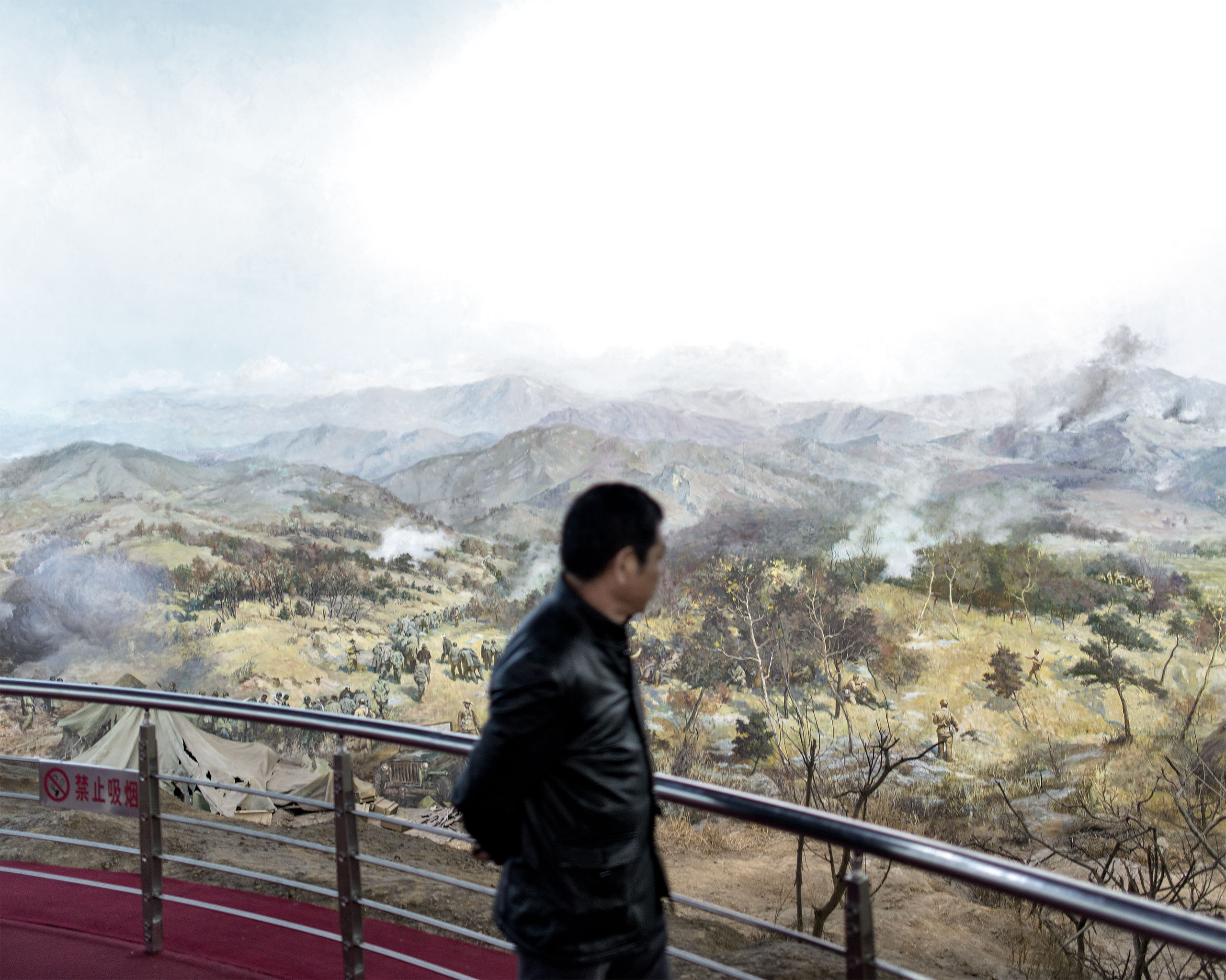 A man observes a diorama in China's only Korean War museum in Dandong, China. The Chinese People's Liberation Army entered Korea to fight against the United States involvement when the Korean War broke out in 1950.  Dandong, a frontier town, experienced first-hand the horrors of war.