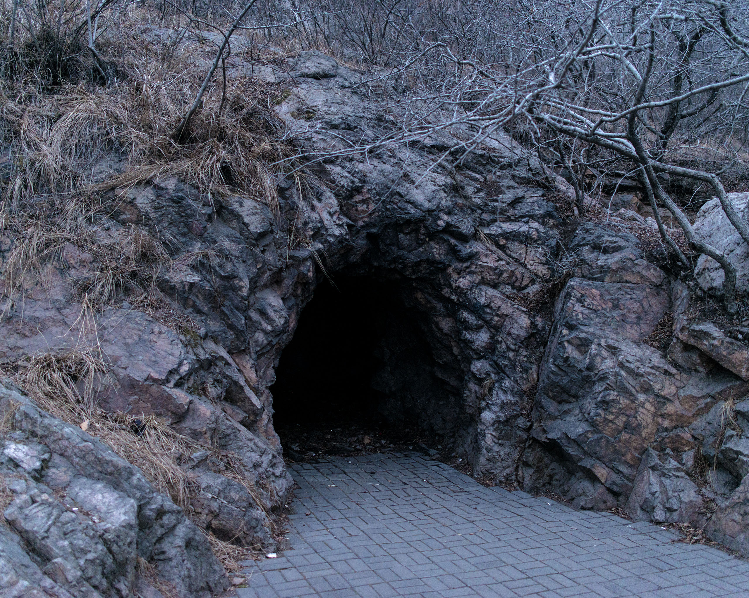 A cave near the Yalu River in the expanding city of Dandong. Caves are used by defectors fleeing from North Korea to hide.