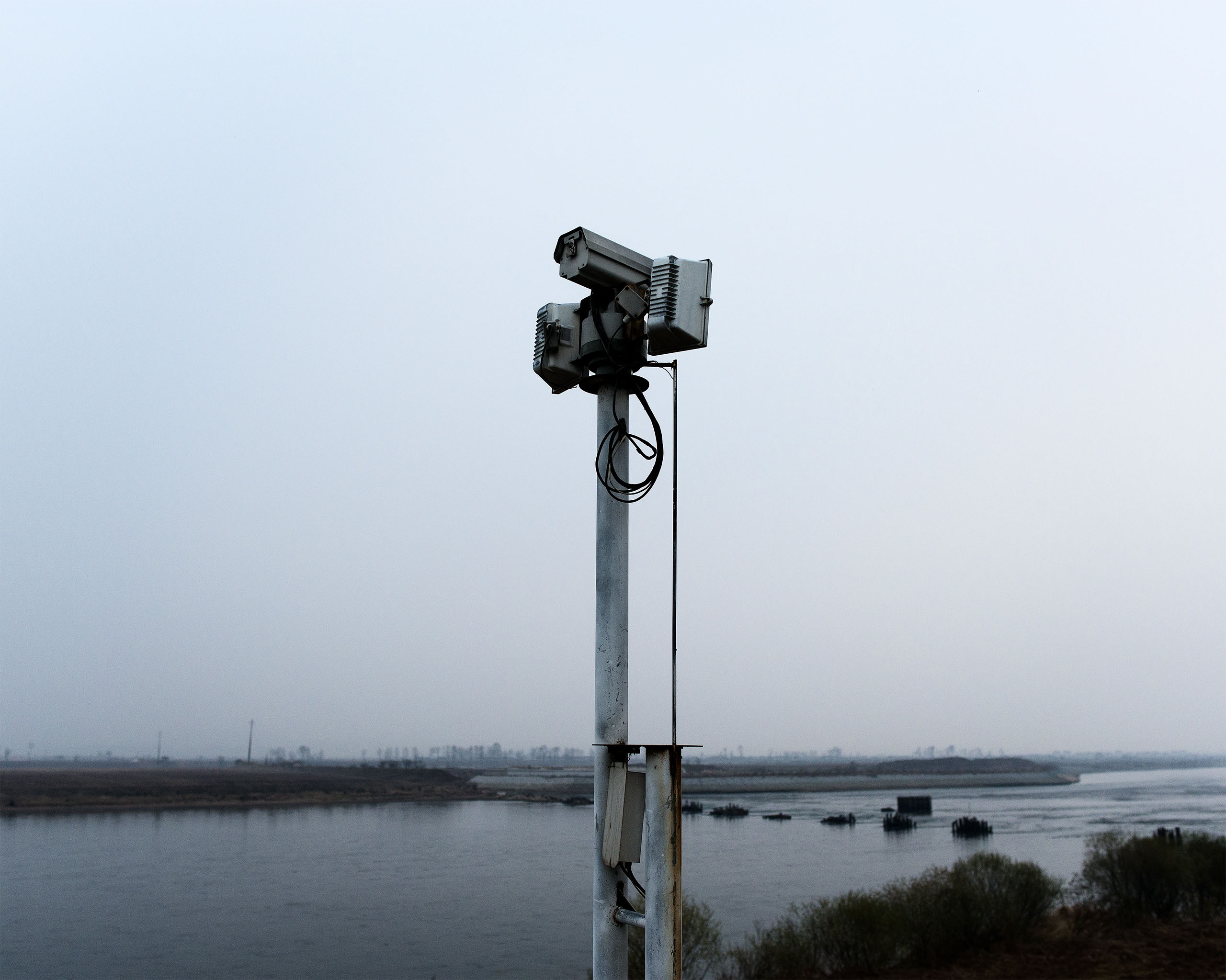 Security cameras in                               Dandong, China keep watch over a narrow stretch of the Yalu River that is sometimes crossed by North Korean defectors.