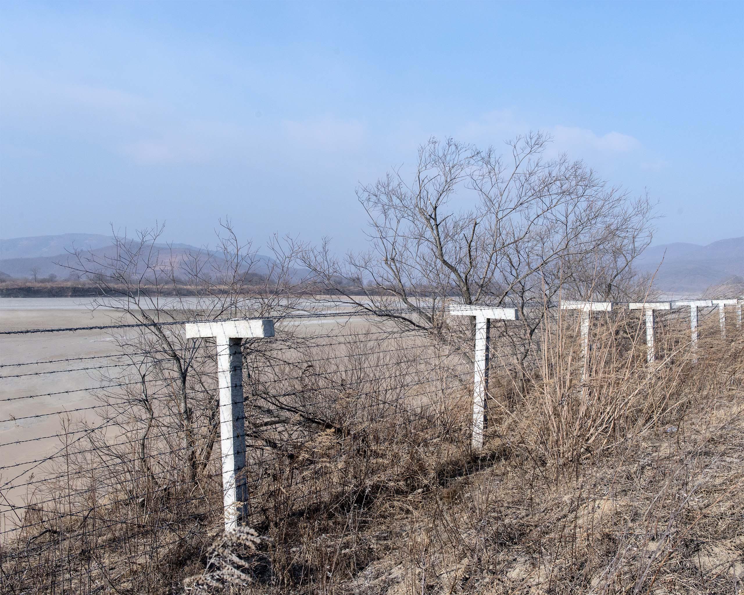 A border fence near Hunchun, China that separates  China and North Korea.
