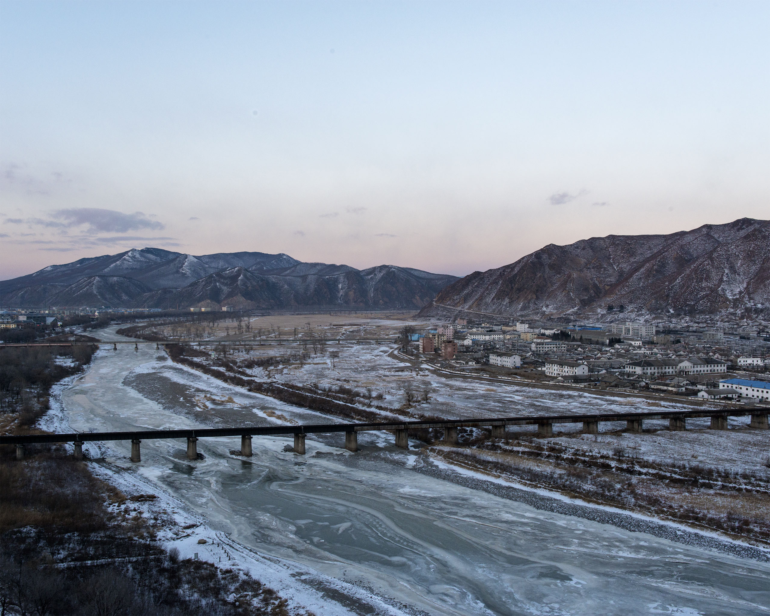 A view of the Tumen river which separates Tumen, China from Namyang, Onsong county, North Korea, at left. Tumen has a very large population of ethnic Koreans, and a   detention center for captured North Koreans awaiting deportation.