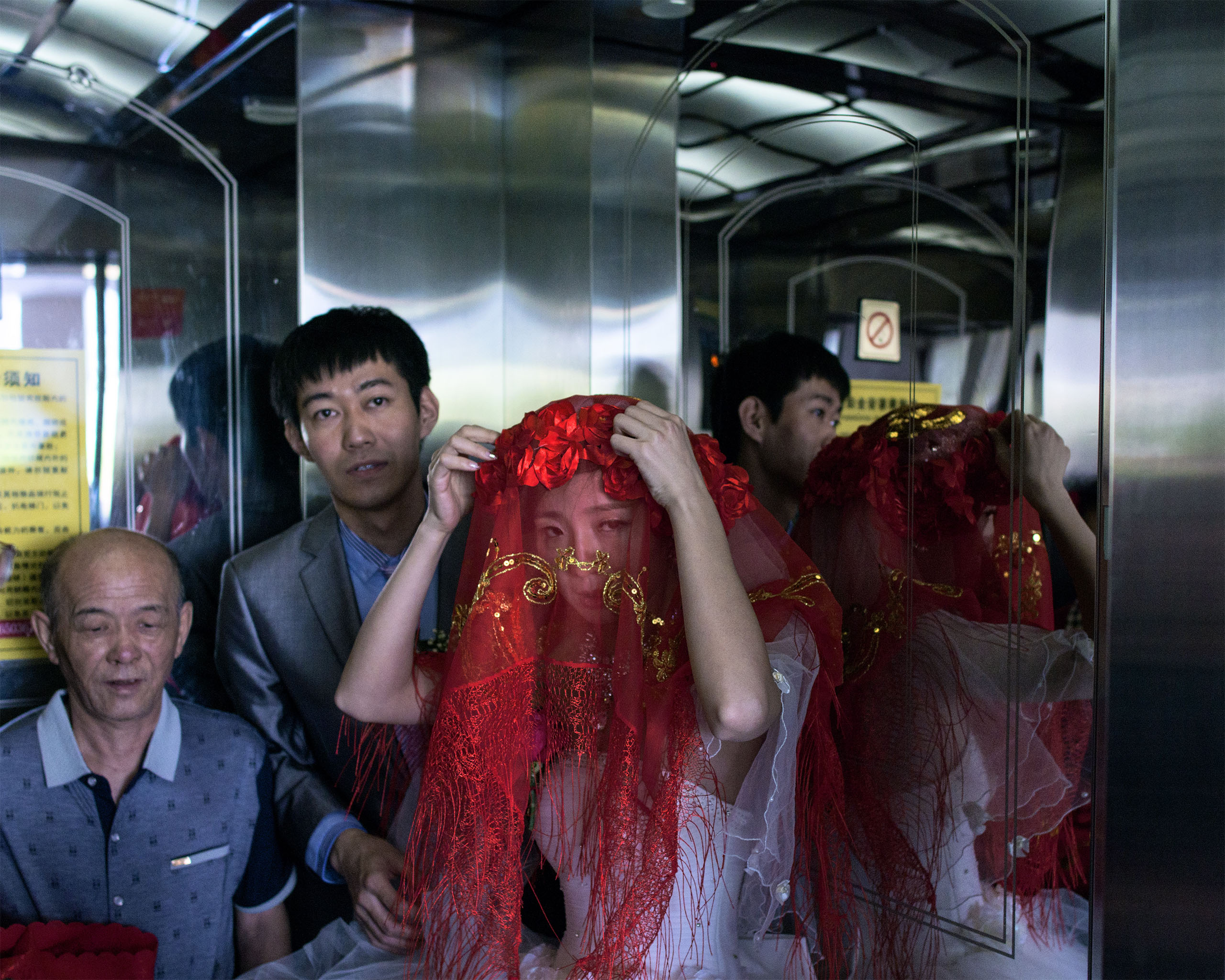 A bride adjusts her veil                               near Jian, China, about                               1 km away from the                               North Korean border.