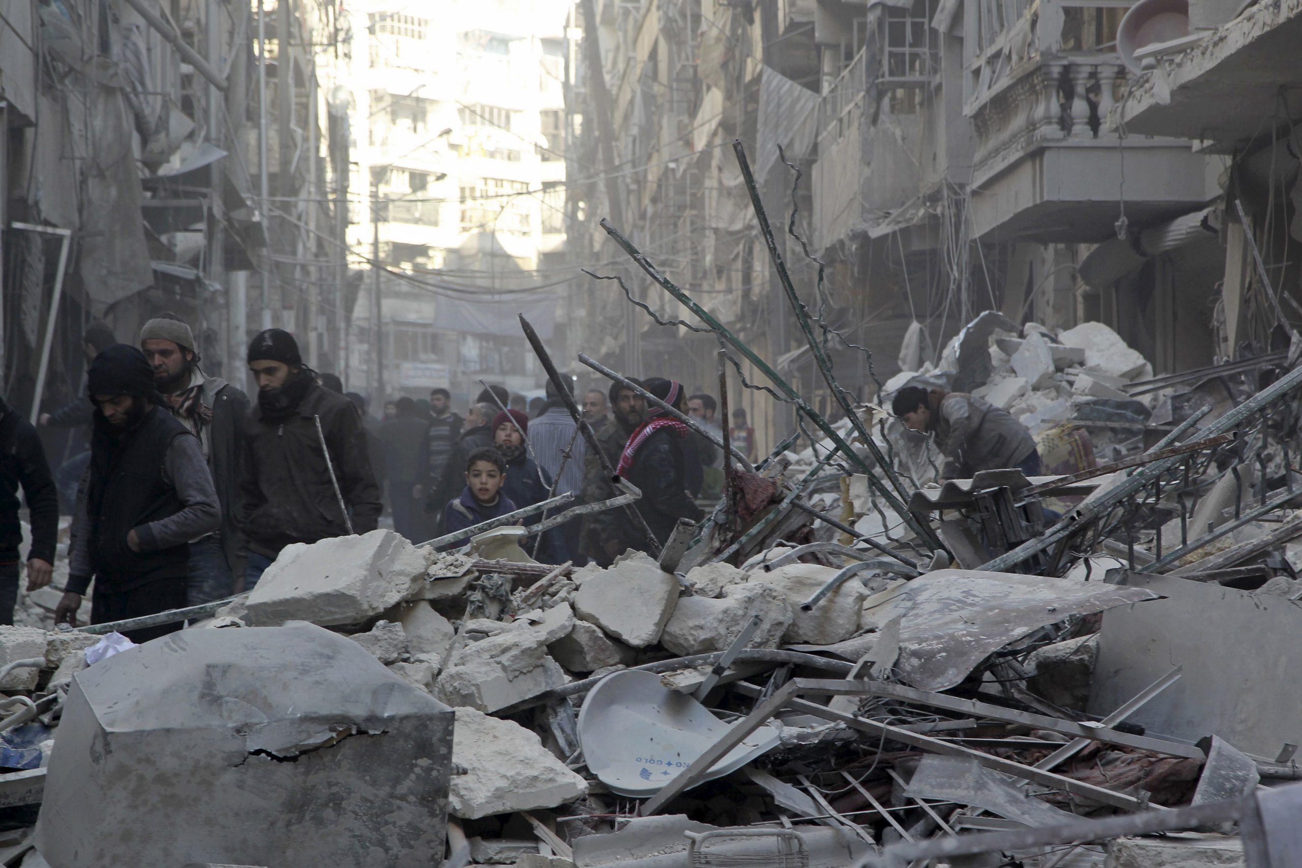 Residents inspect damage after airstrikes by pro-Syrian government forces in the rebel held Al-Shaar neighborhood of Aleppo, Syria, on Feb. 4, 2016.