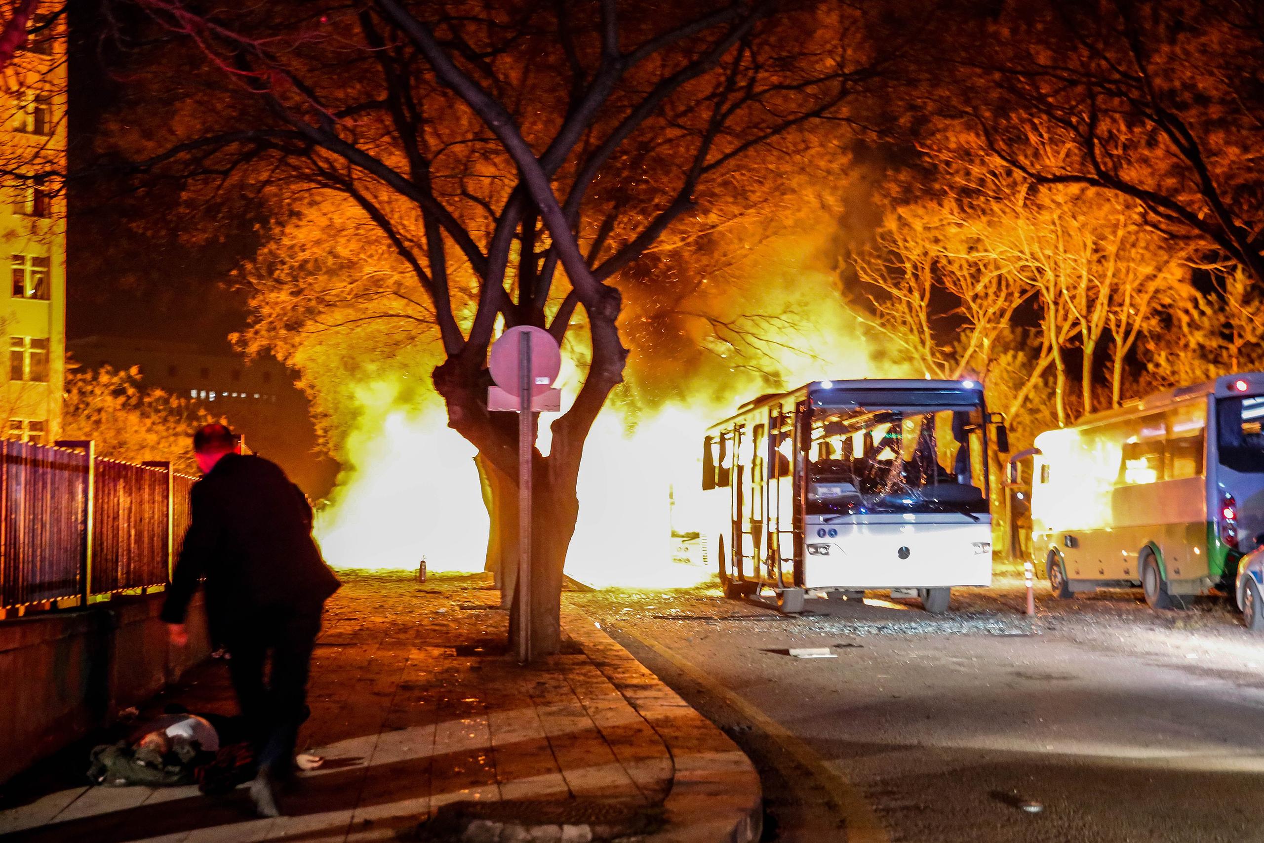 Army service buses burn after an explosion in Ankara, Turkey, Feb. 17, 2016.