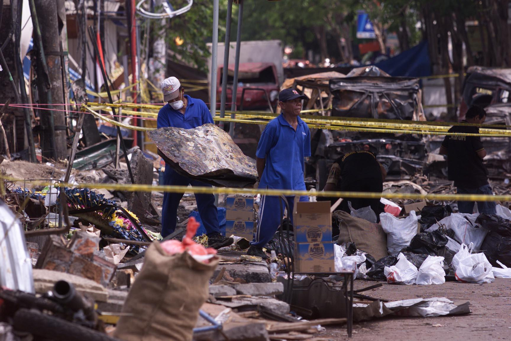 File photo dated Oct. 16, 2012, of investigators removing debris from the Sari Club in Kuta, Bali, bombed by the extremist group Jemaah Islamiyah