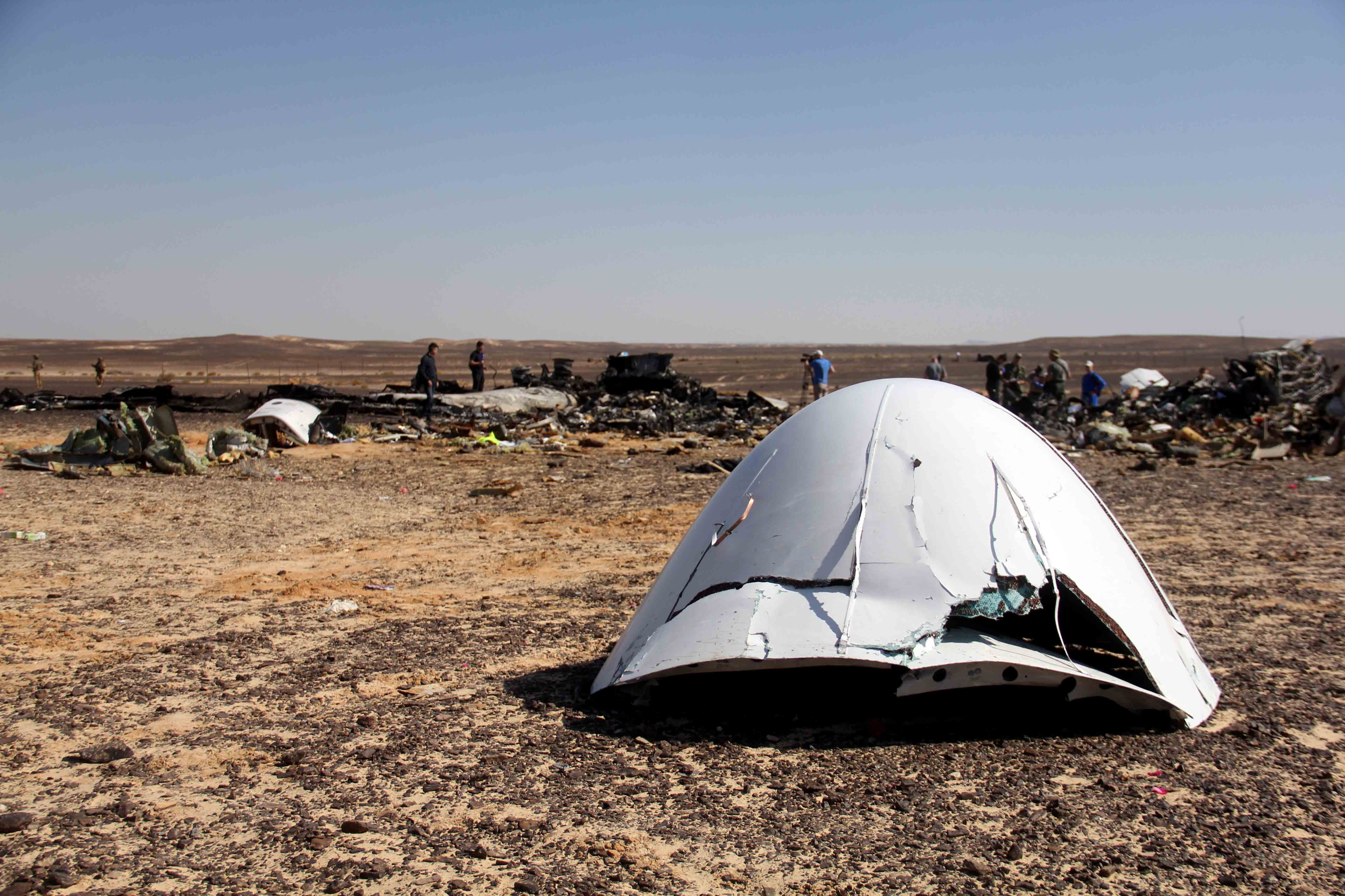 Debris of a Russian airplane is seen at the site a day after the passenger jet bound for St. Petersburg, Russia, crashed in Hassana, Egypt.