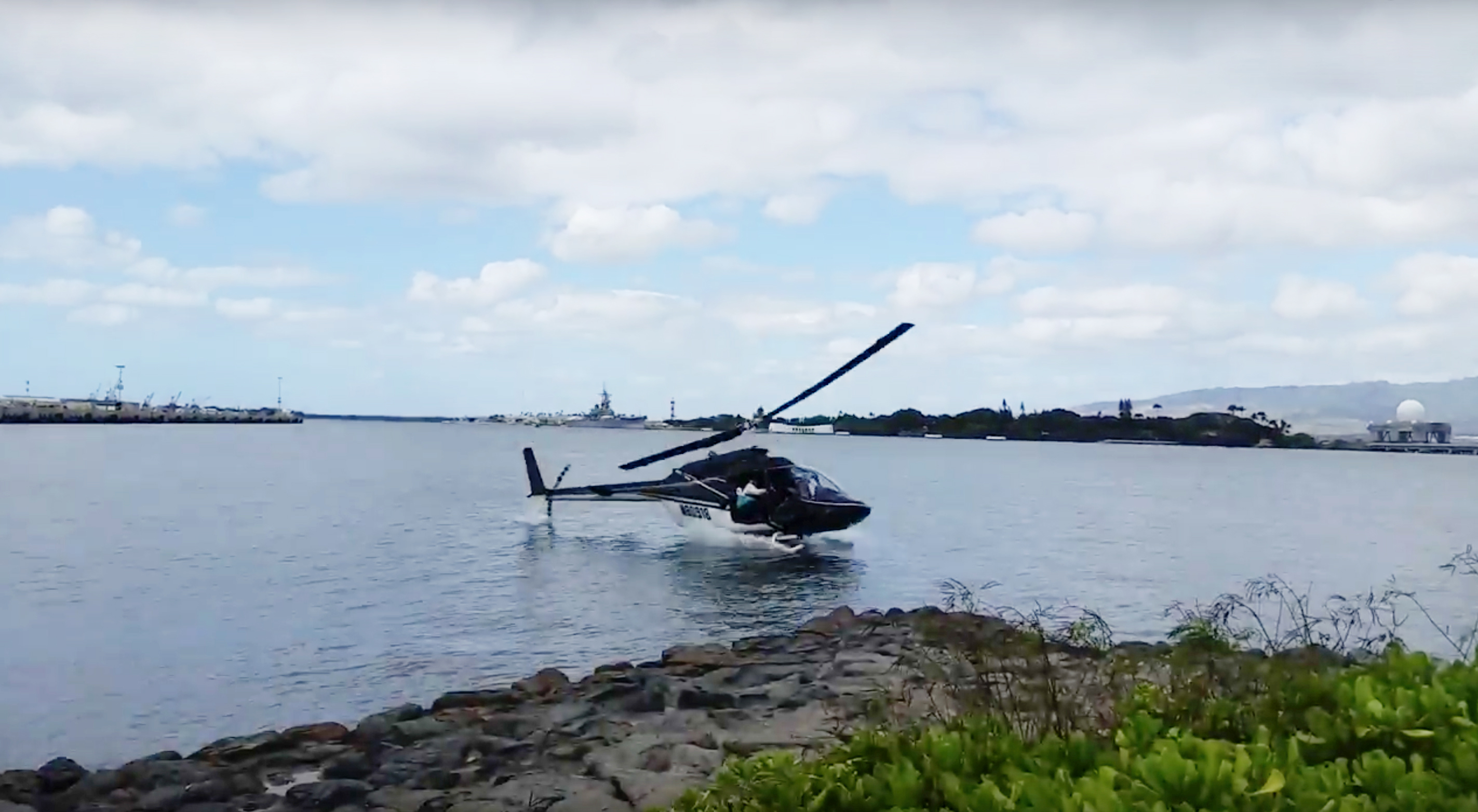 In this image taken from video provided by Shawn Winrich, a helicopter crashes near Parl Harbor, Hawaii, Feb. 18, 2016