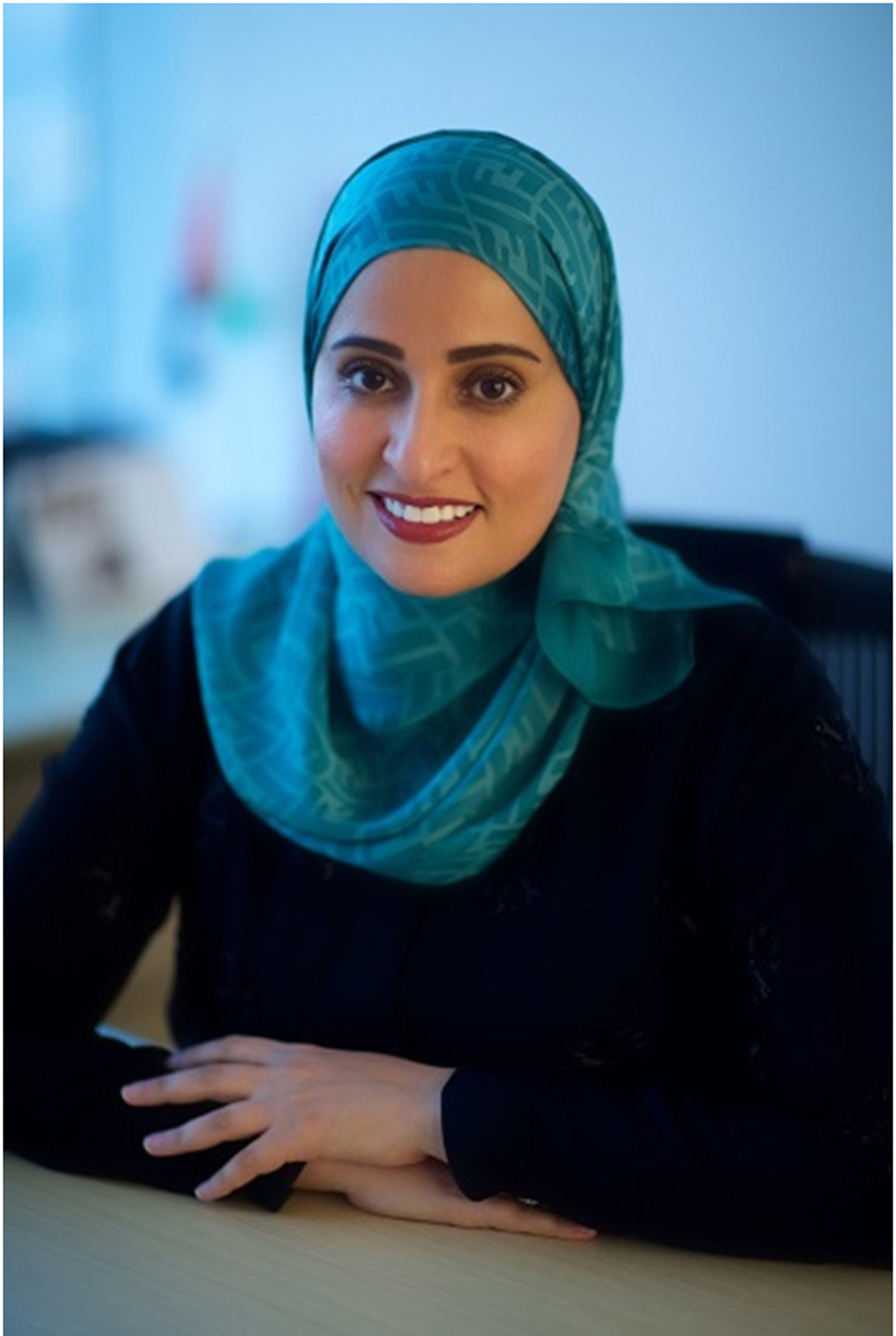 This undated image released by the Emirates News Agency, WAM, shows Ohood Al Roumi, the Minister of State for Happiness of the United Arab Emirates